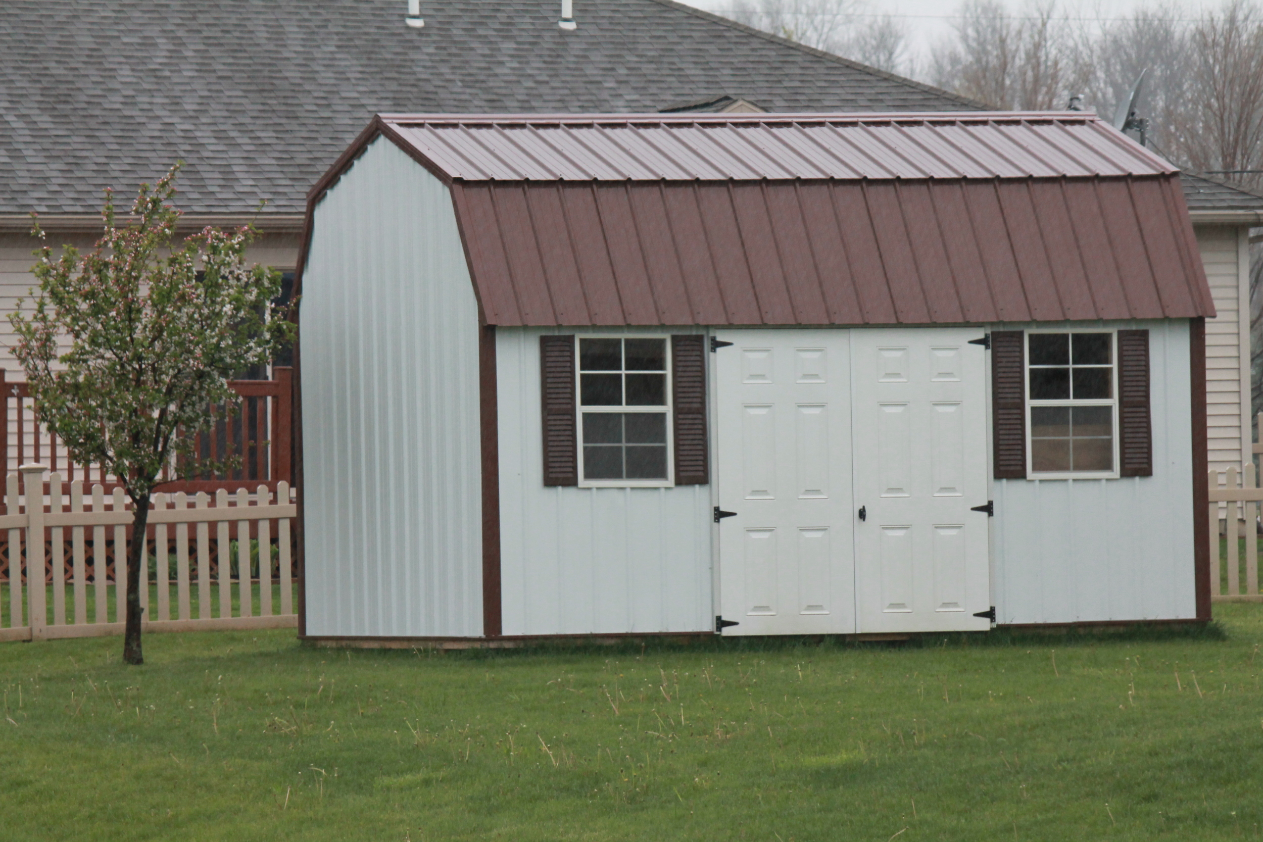 side lofted metal barn with a metal roof (2) delivered to personal property..JPG