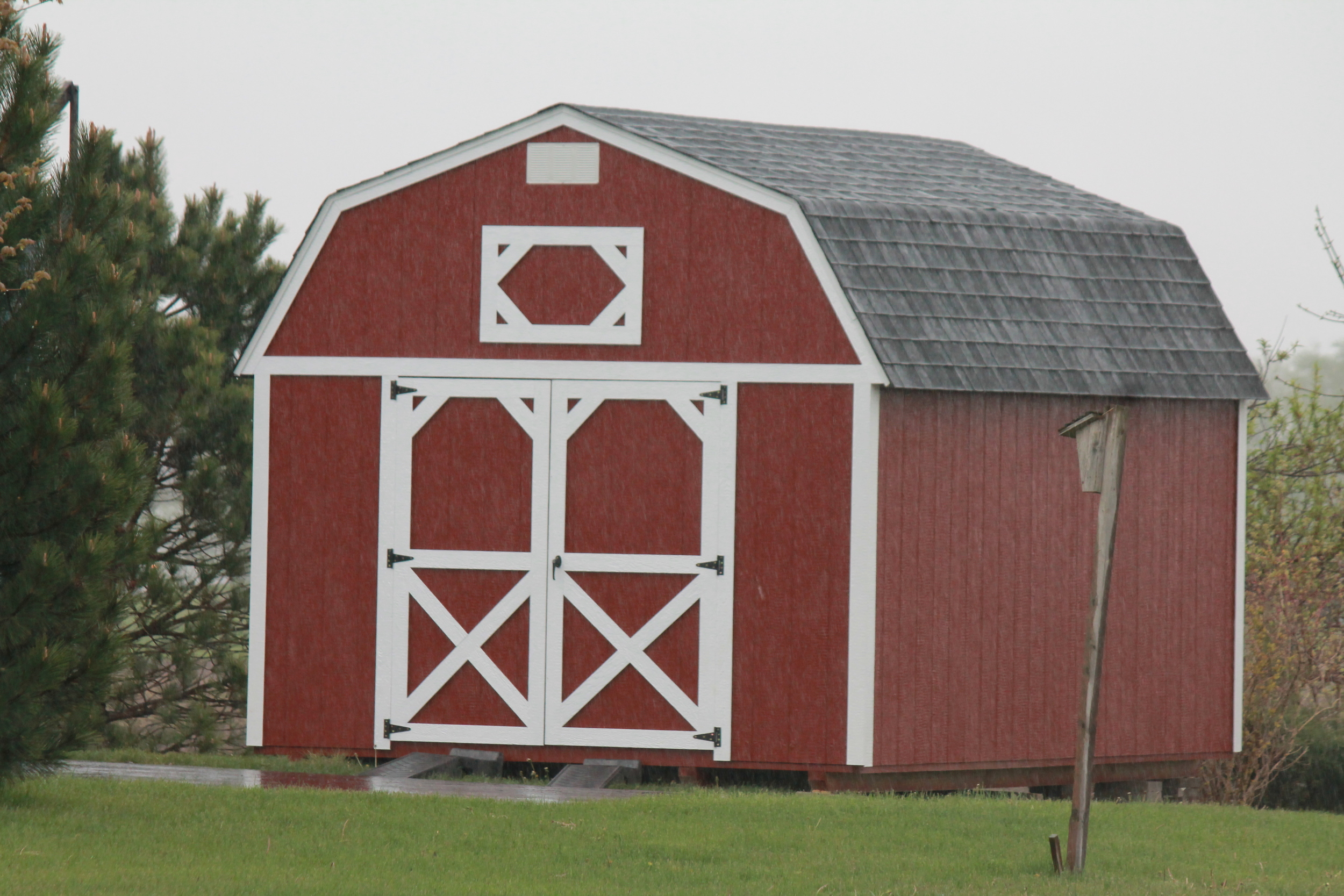 painted pressure treated lofted barn with shingled roof delivered to customer (2).JPG