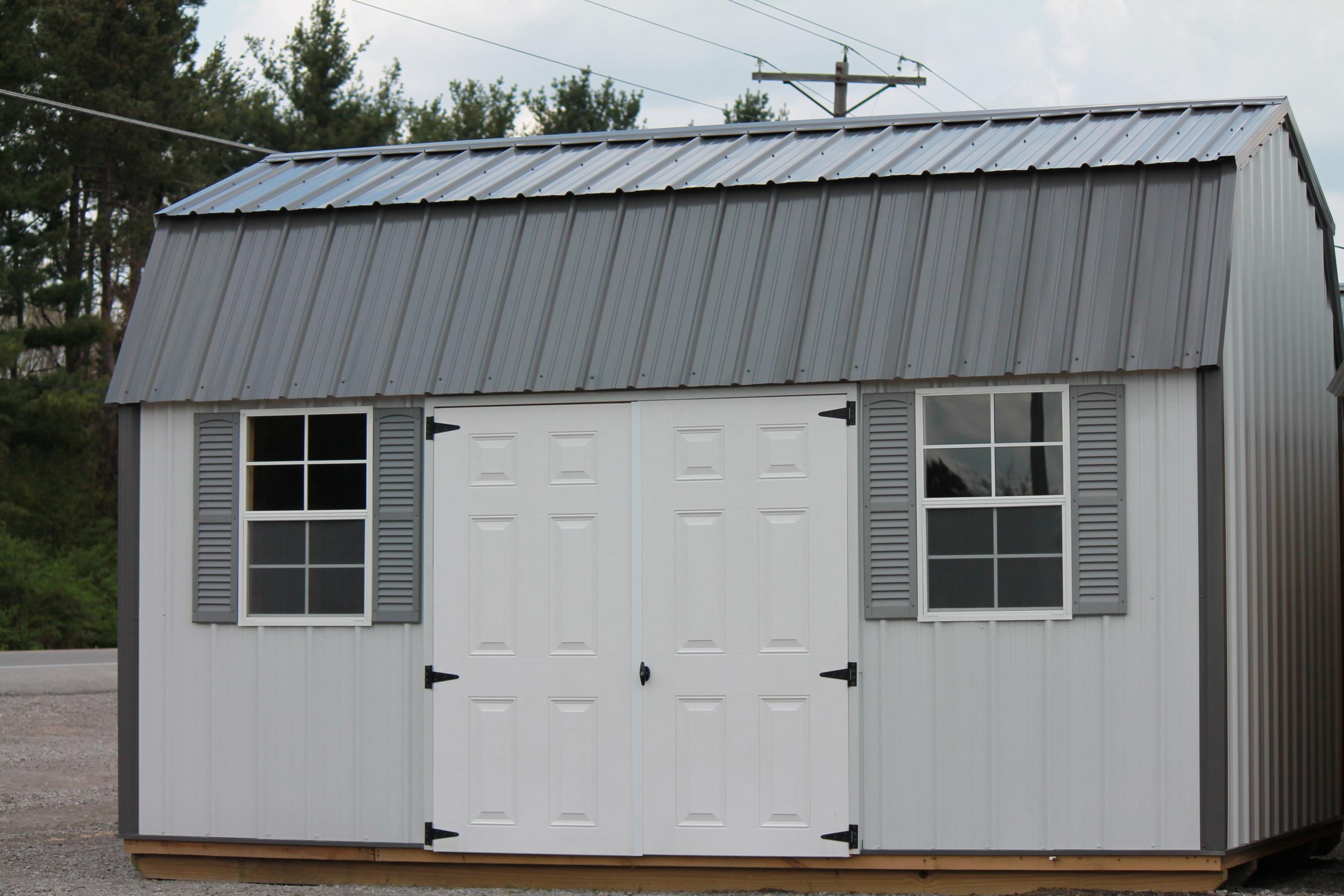 side lofted metal barn with a metal roof.JPG