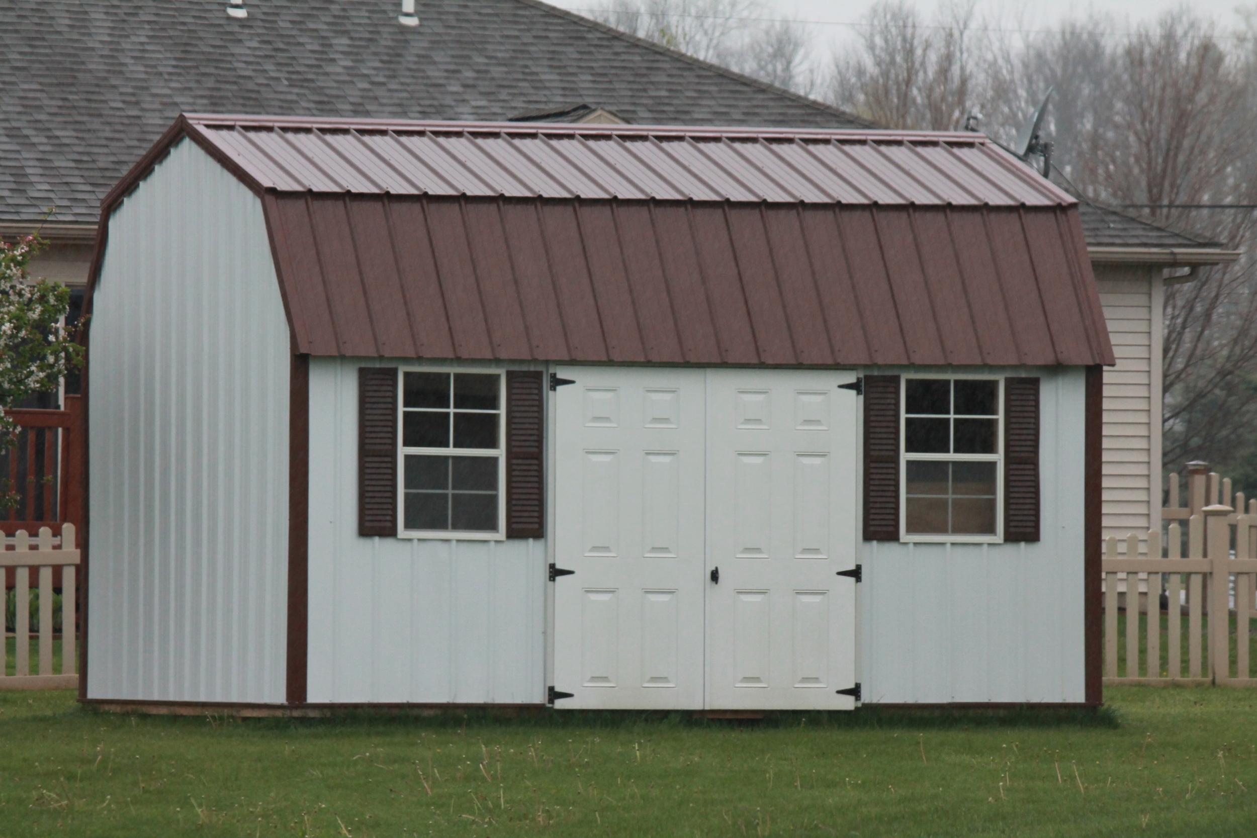 side lofted metal barn with metal roof.JPG