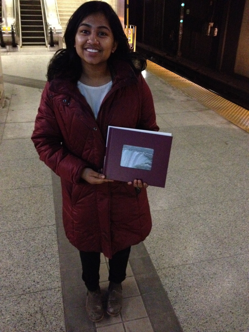 Larisa Julius and her Bendale Retirement Home bound photobook.