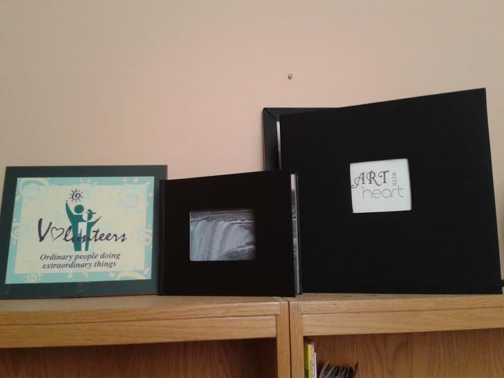 The original photobook donated to Fudger House (right) with the new photobook we made (center), and a volunteers plaque (left). We've come a long way!