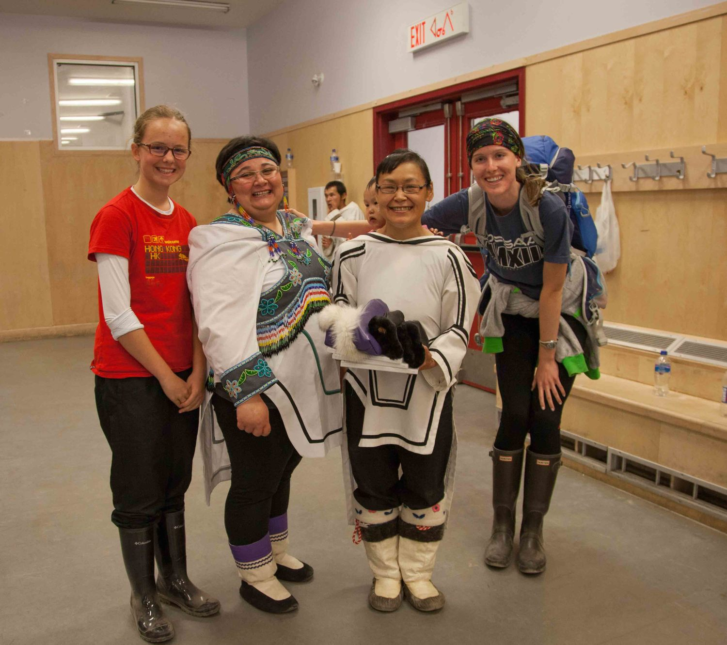 At the cultural centre in Pond Inlet, Nunavut, giving 3 photo books.