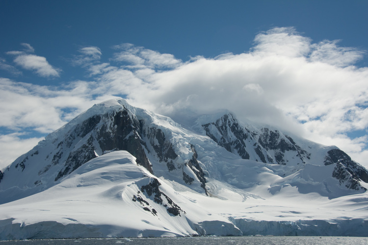 Image by Eva Wu as the Students on Ice vessel M/V Ushuaia sails through the Lemaire Channel, Antarctic Peninsula.