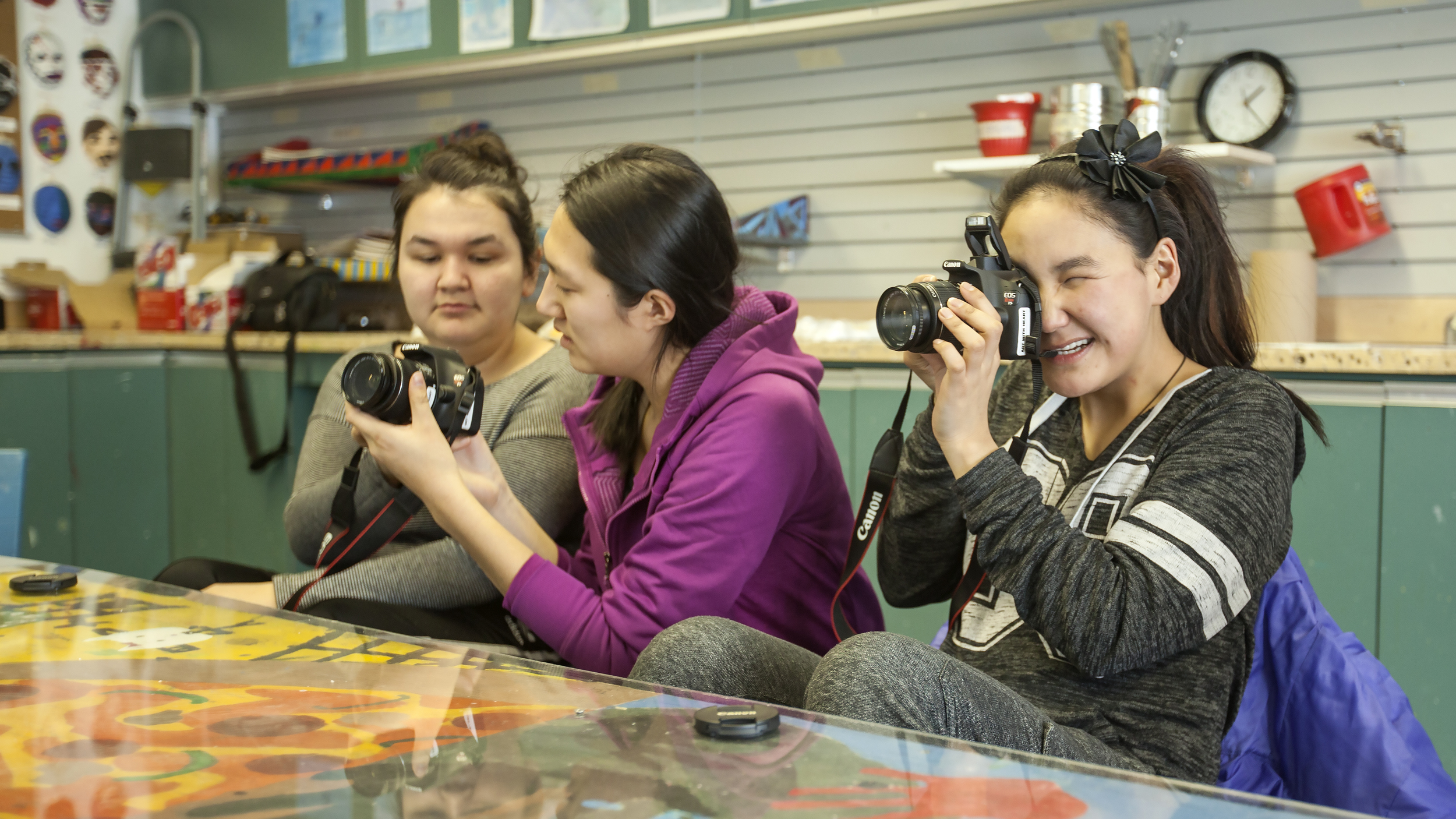 NIF co-founder Eva Wu teaching some students how to use the cameras. Photo by Eric Foss.