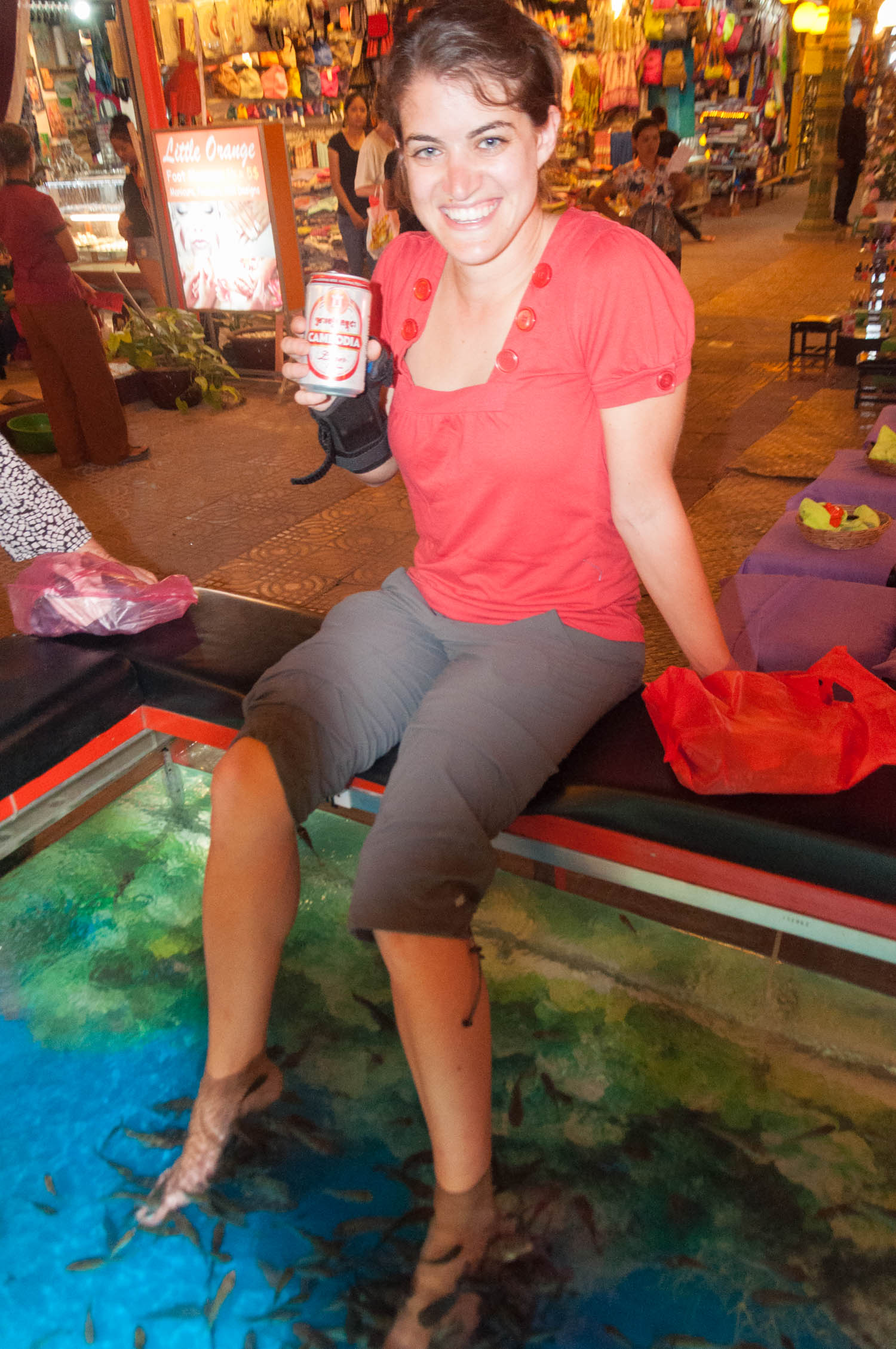 - Walking along Pub Street in Siem Reap, Cambodia I saw this girl with her feet in this huge fish-tank, and I took the photo above. I asked her if it tickled, she said it did at first, but then you get used to it. The fish feed on your dead skin cells, cleaning it while they eat. It's sort of like a pedicure, when they scrape your feet.So a little later that night, I tried it. I had heard about it from friends, so I figured why not. I walked up to a place with a giant fish tank and asked how much it cost.$2 GETS YOU A BEER &30 MINUTES IN THE TANKSeemed like a good deal to me. I can't remember the last time I laughed that hard. A few of us stuck our feet in and hysterics ensued for the first 5 or 10 minutes, but eventually it stopped tickling and we began to watch the patterns of the fish. Big fish claiming territory on the best tasting feet and scaring away the smaller fish. It was a very cool experience, but one I'll remember next time I see tilapia on a menu.