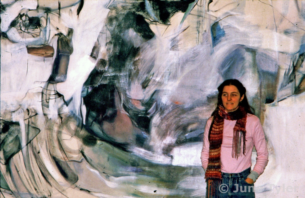 "In this photo, (taken in the early 80's,) I am standing in front of my oil on canvas, 1979, ""Winter Storm"" at Cayuga Community College in Auburn, NY. I believe the painting is still there in the library building. I taught art at Cayuga for many years before moving to Norwich."