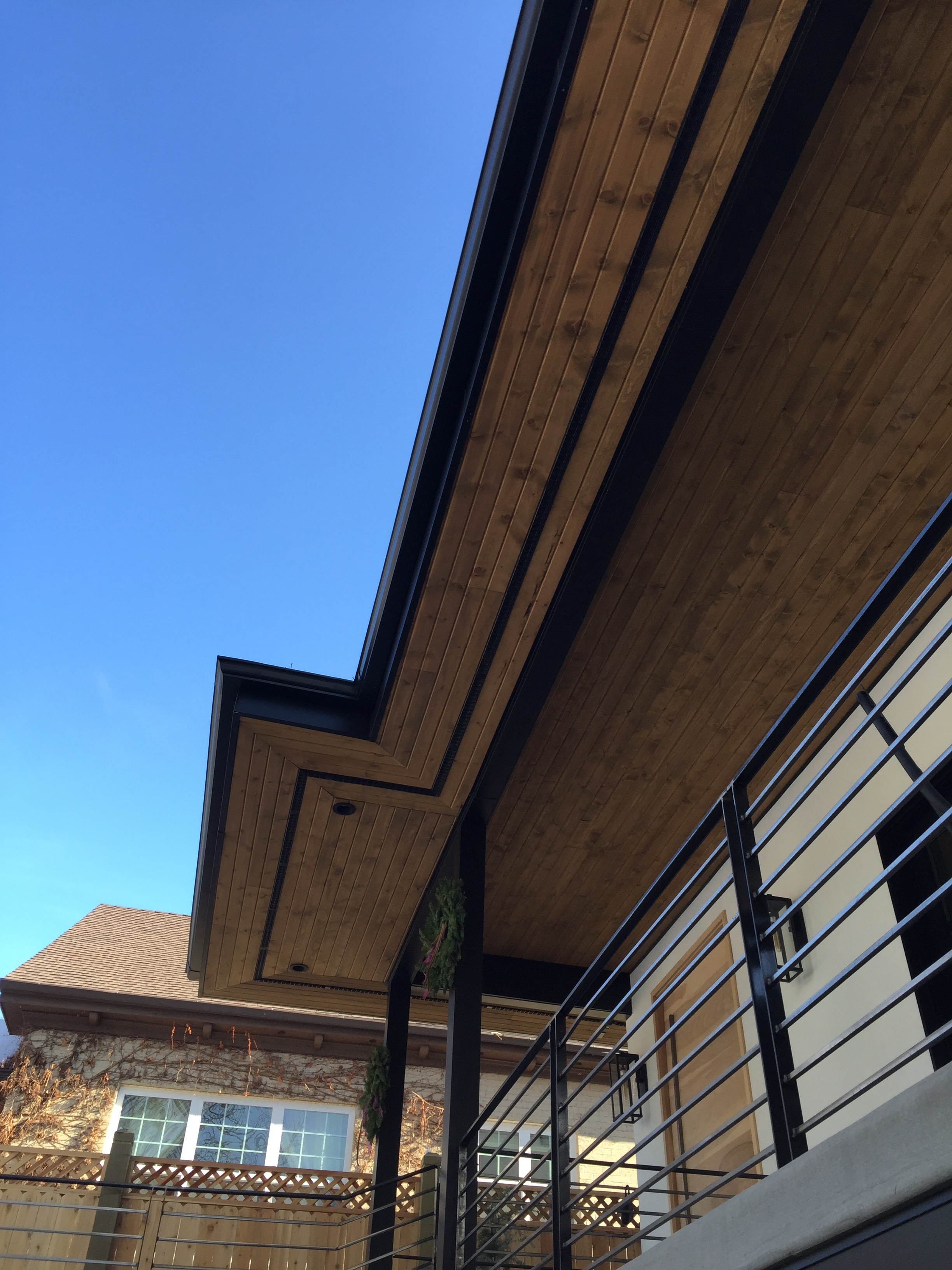 Aluminum fascia, wood tongue and groove soffit, aluminum rain gutter