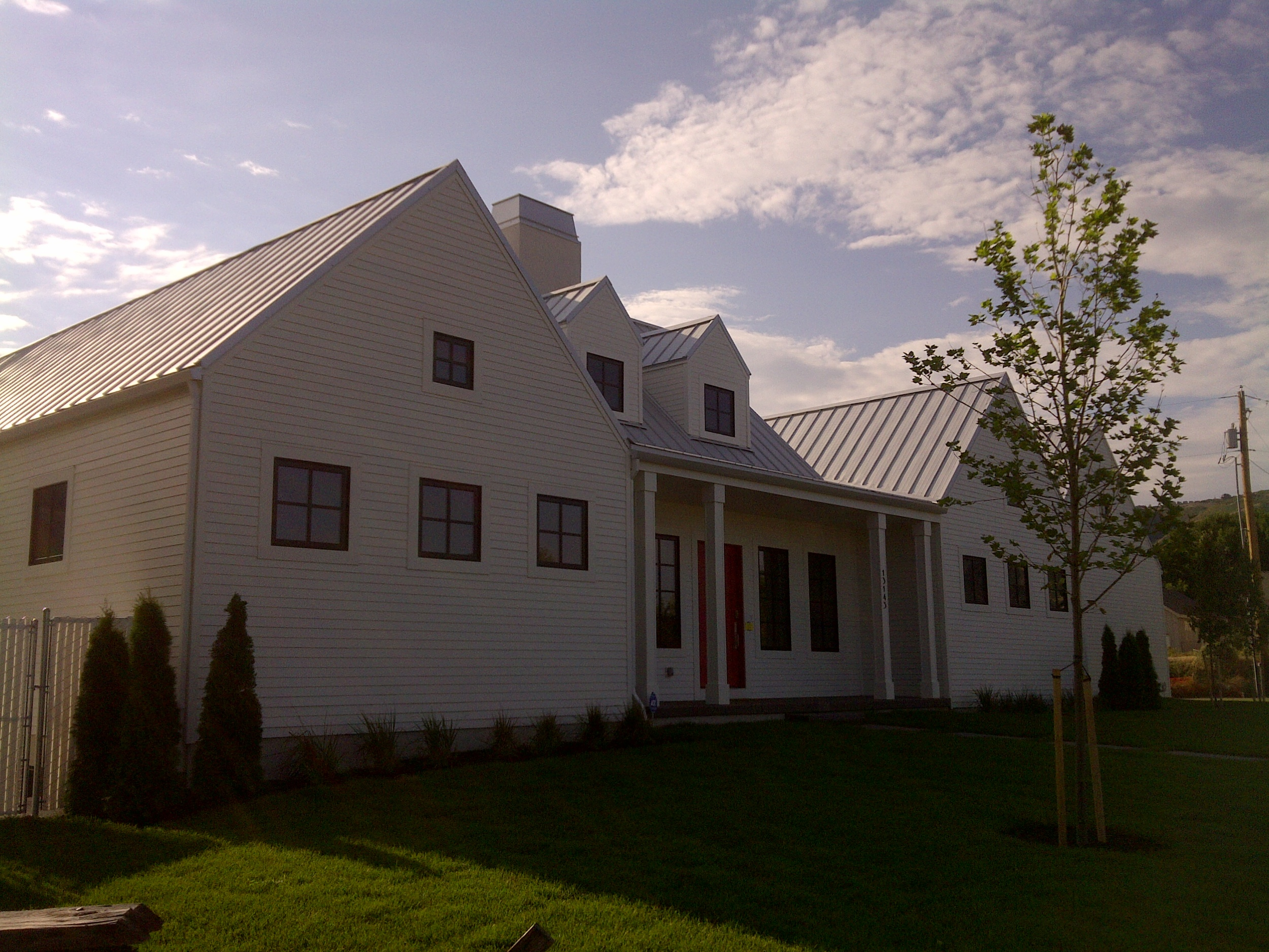 Fiber cement siding, white farm house