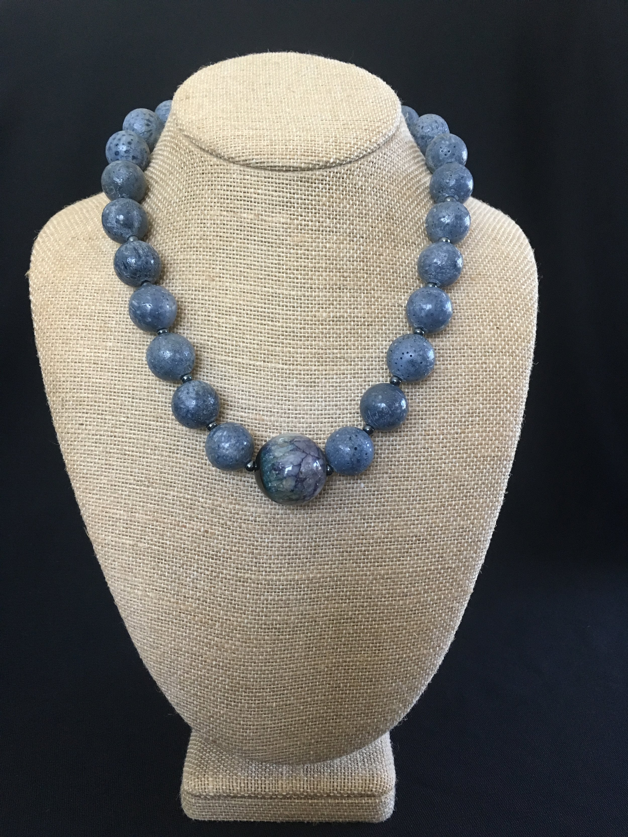 "Agate center and blue coral with sterling clasp. 19"" $75"
