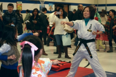 Sensei Etsuko is teaching karate to students from Thomas Dooley Elementary School for Japanese Cultural Night.