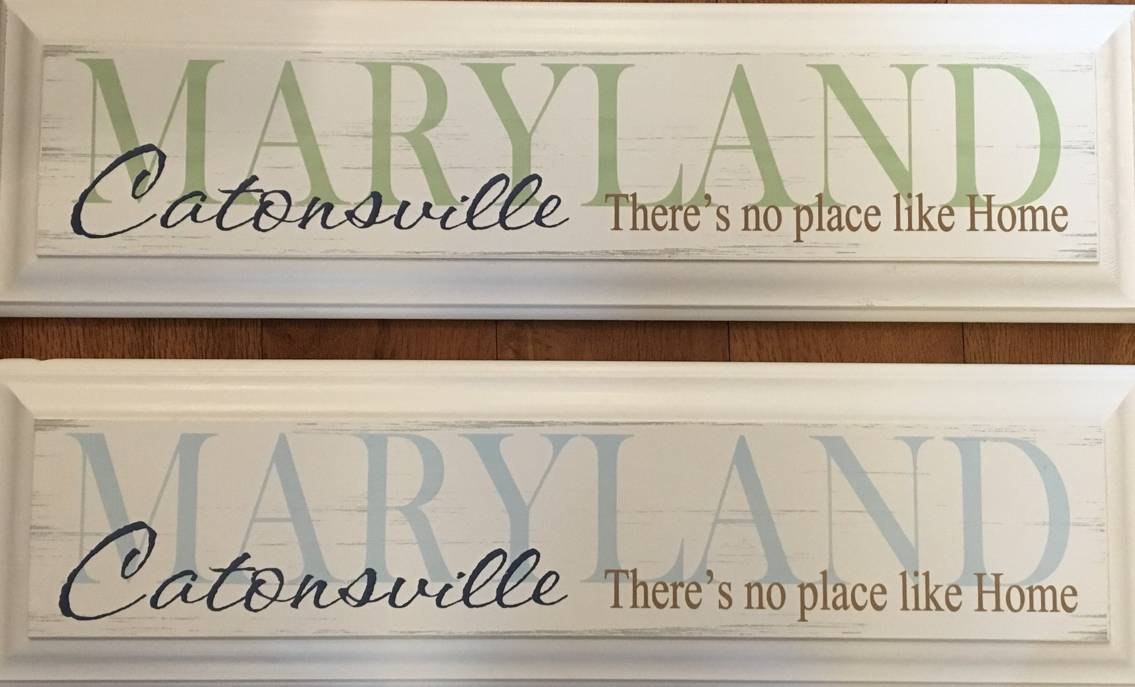 "CATONSVILLE There's No Place Like Home Wooden Sign    19 1/2""x5 1/2""    Available in Blue or Green    $20.99"