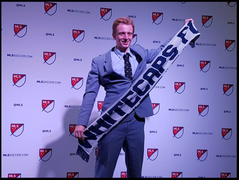 Francis de Vries poses after being selected 29th overall in the 2017 MLS Superdraft