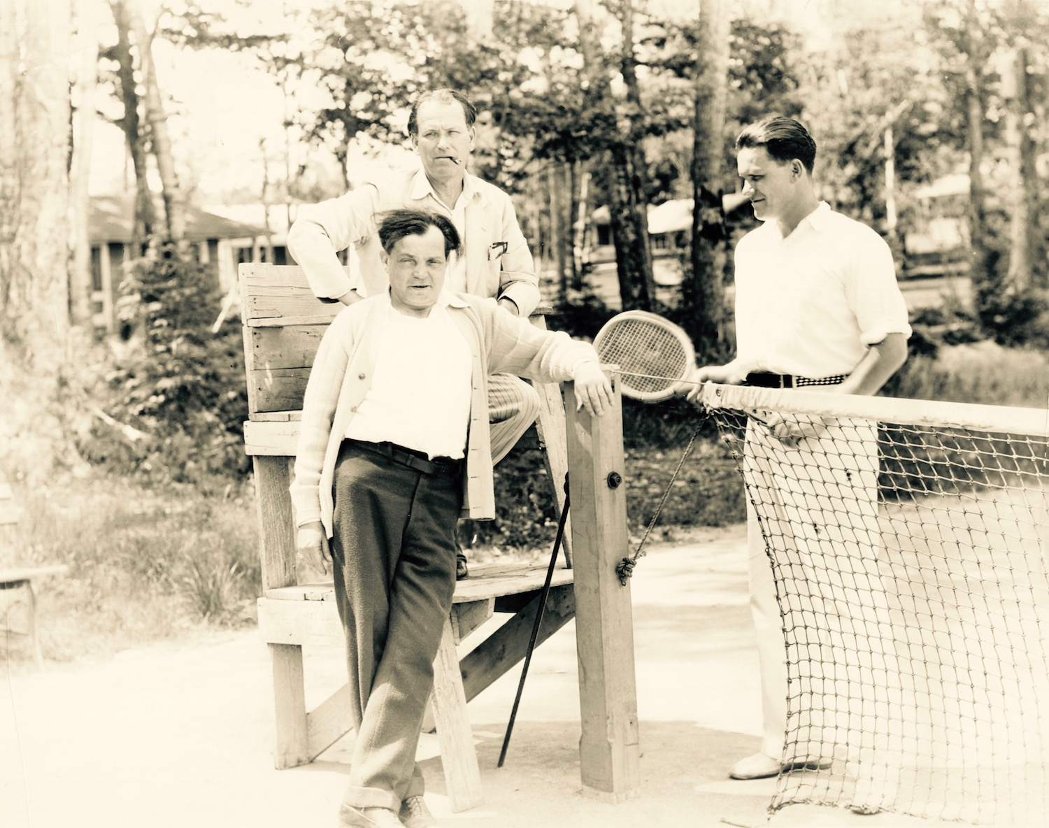 Warren Hymer (standing right) with his father, playwright John B. Hymer (seated) and playwright Sam Shipman (standing left) at the tennis courts at Lakewood.  (Author's collection.)