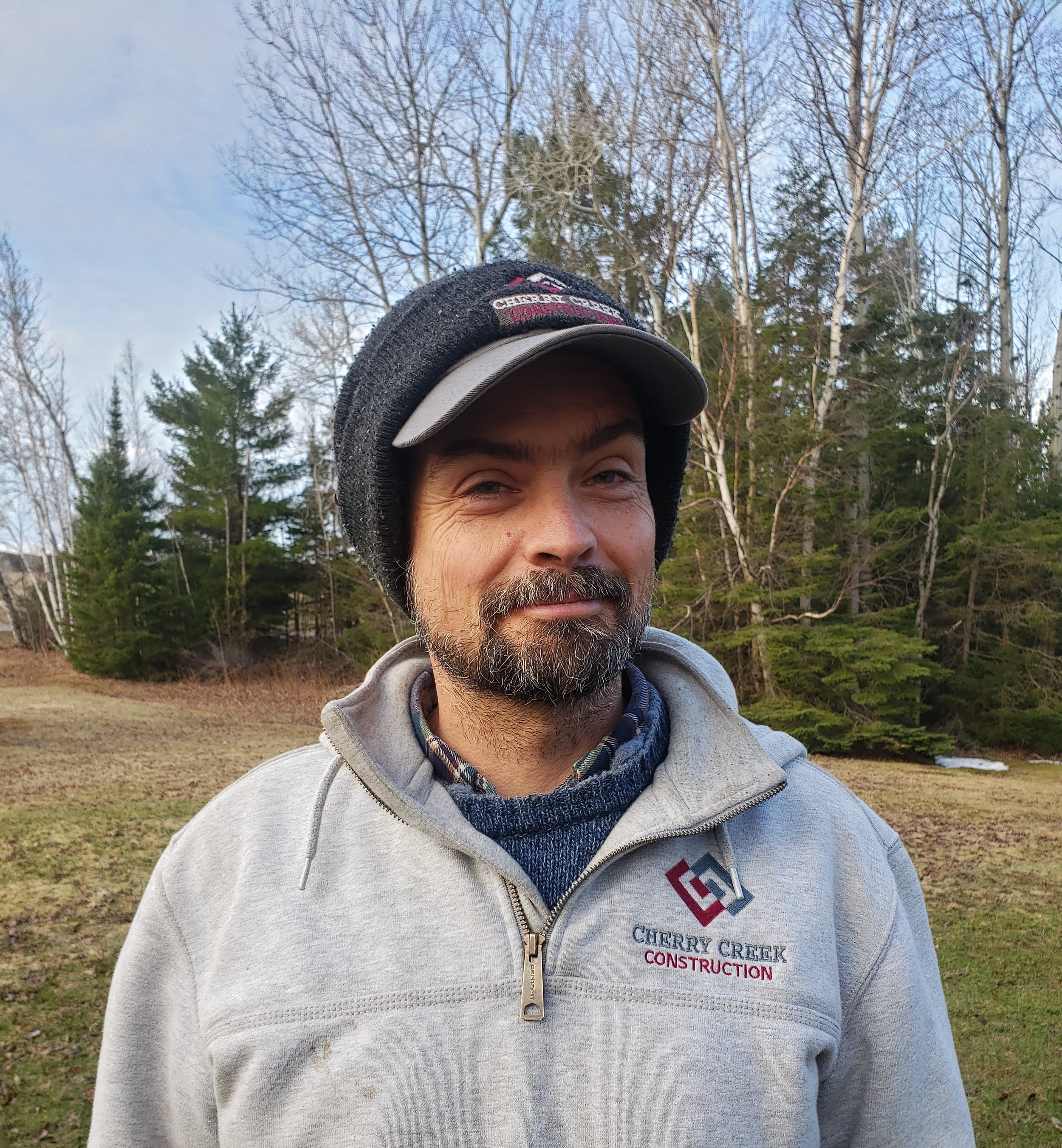 Chris Cookingham - Chris, carpenter, has lived in the U.P. for years and has a keen eye for complicated finish carpentry. In his spare time, he loves to trail run on the miles of single track around Marquette and spend quality time with his daughter.