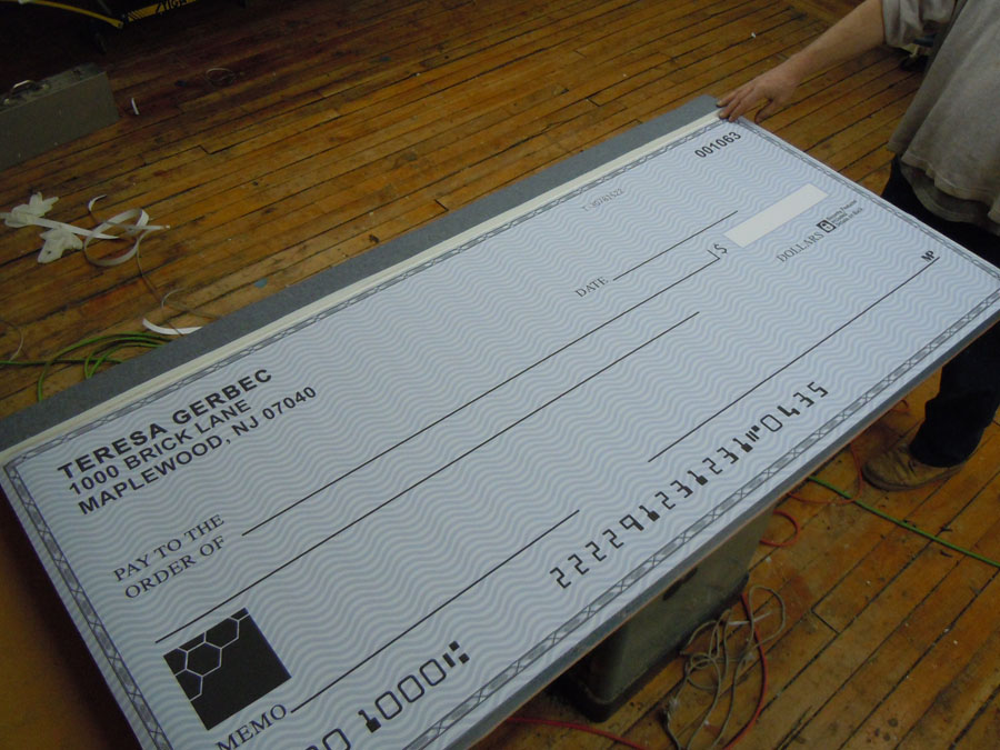 Oversized check book prop for TBS bank commercial