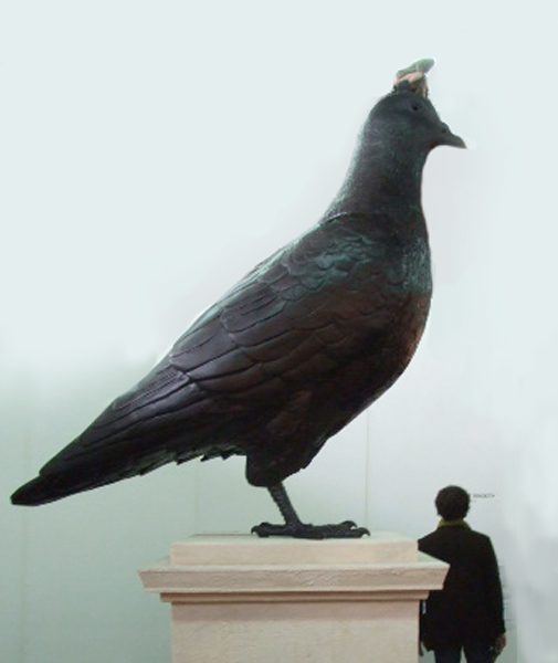 giant bird sculpture with man on top