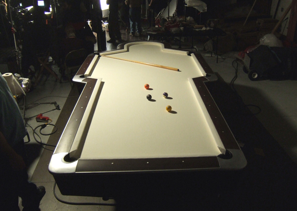 Man shaped pool table prop