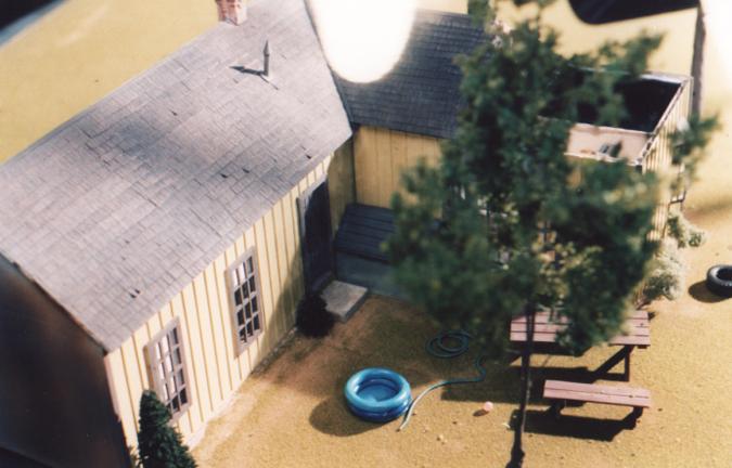 Miniature house model in a Big Brawny parody for SNL