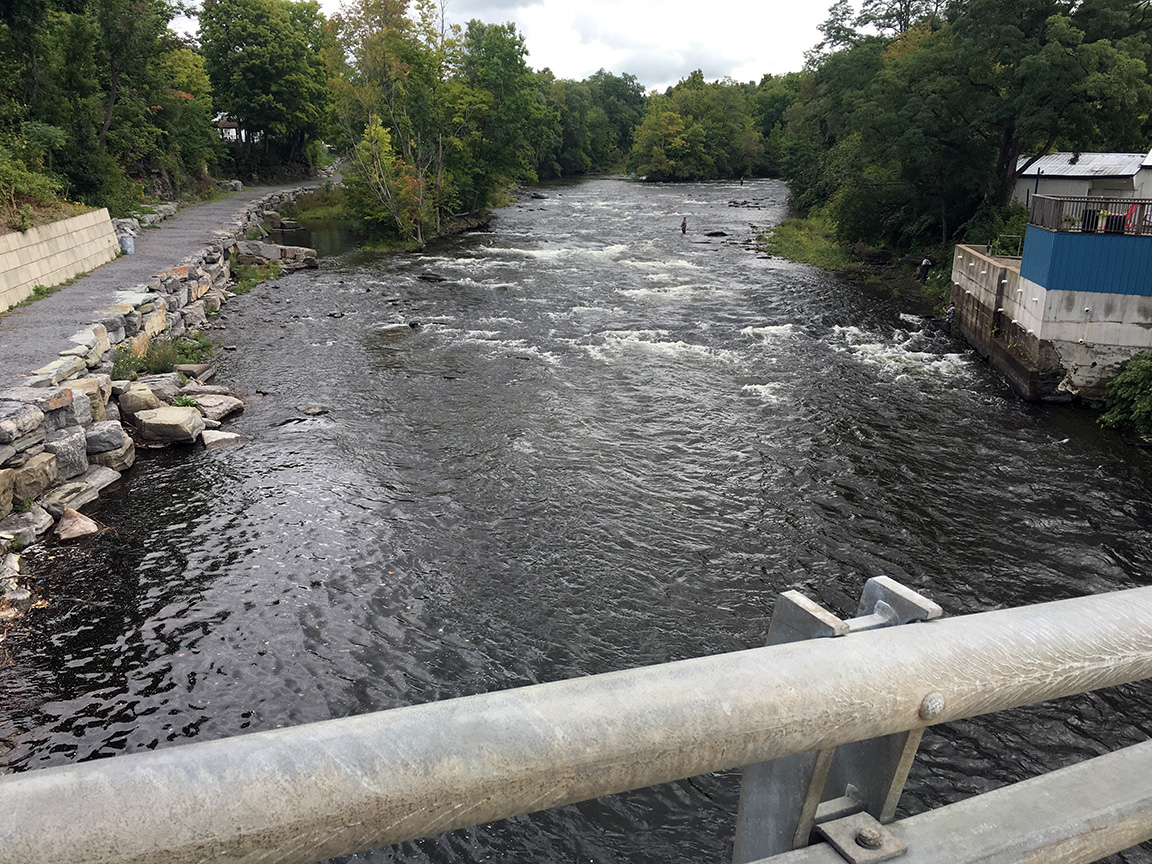 Looking upstream from the bridge at the Town Pool.