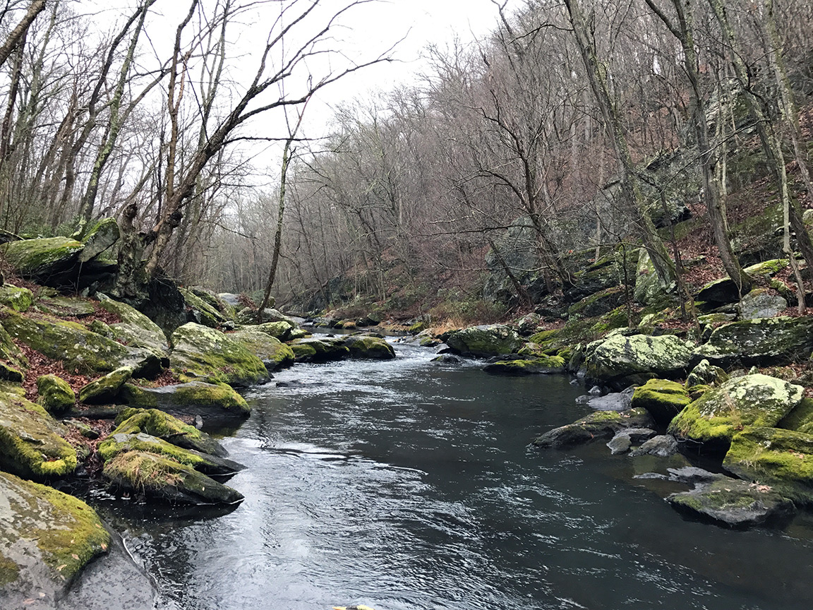 Closer to the dam, the Gunpowder narrows and is strewn with large boulders.