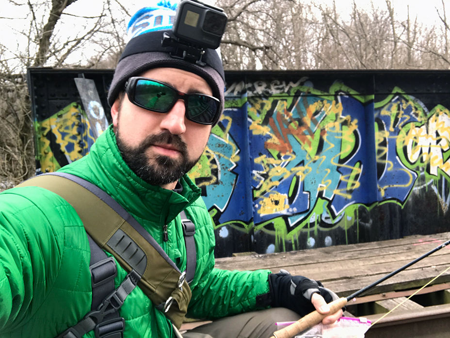 My selfie in front of the the graffiti covered railroad bridge.