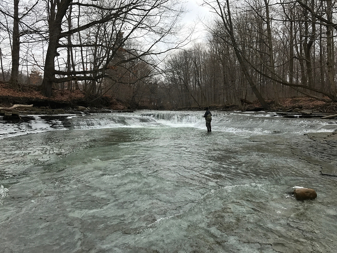 Jon fly fishing the heavy water at the Walnut Creek waterfall.