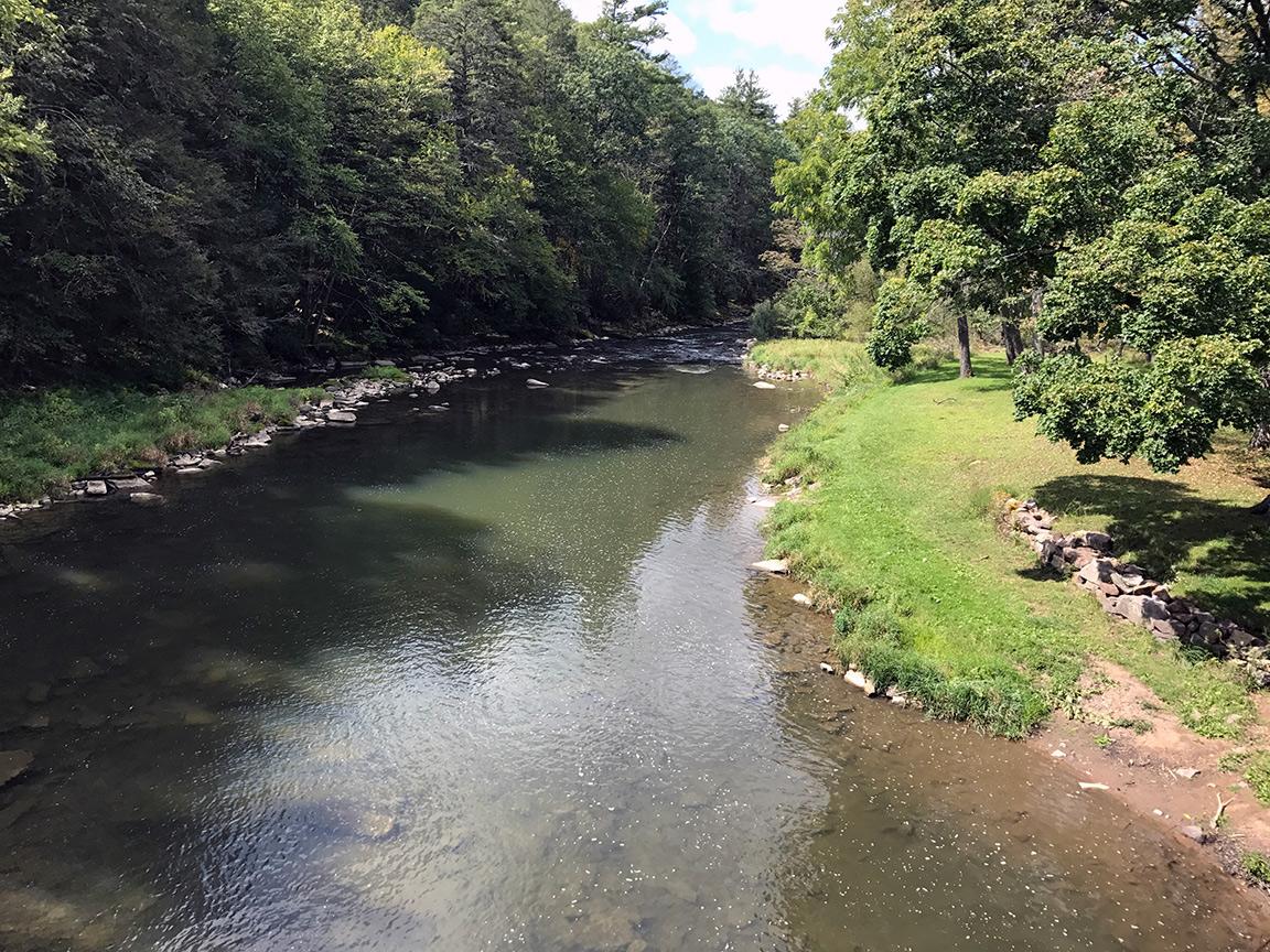 Looking downstream across the deep pool that lies below the Mid-State Trail Bridge.