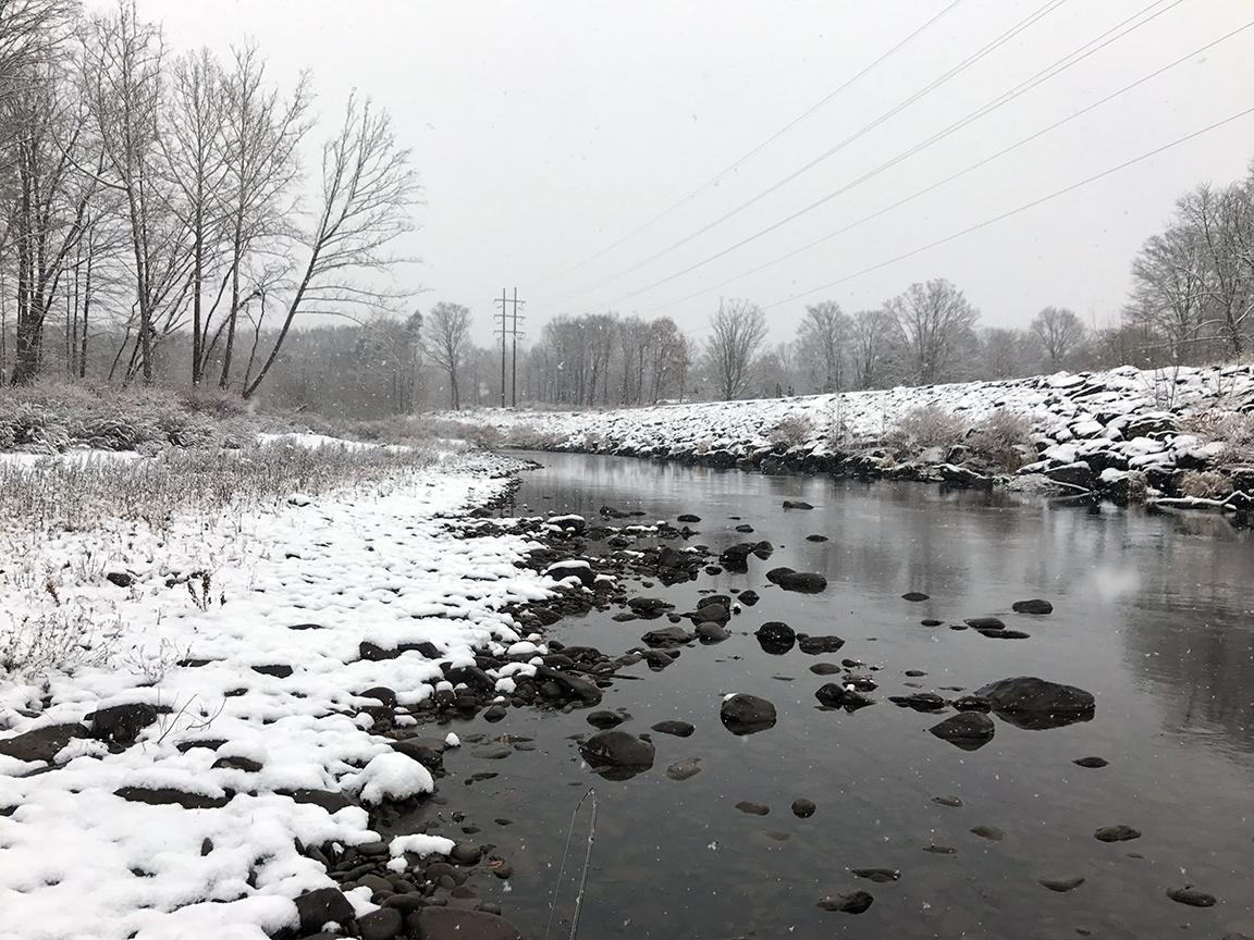 The Brodhead Creek covered in the season's first snow.