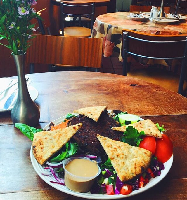 Our mouth watering black bean burger special over a garden salad topped with pita😍😋