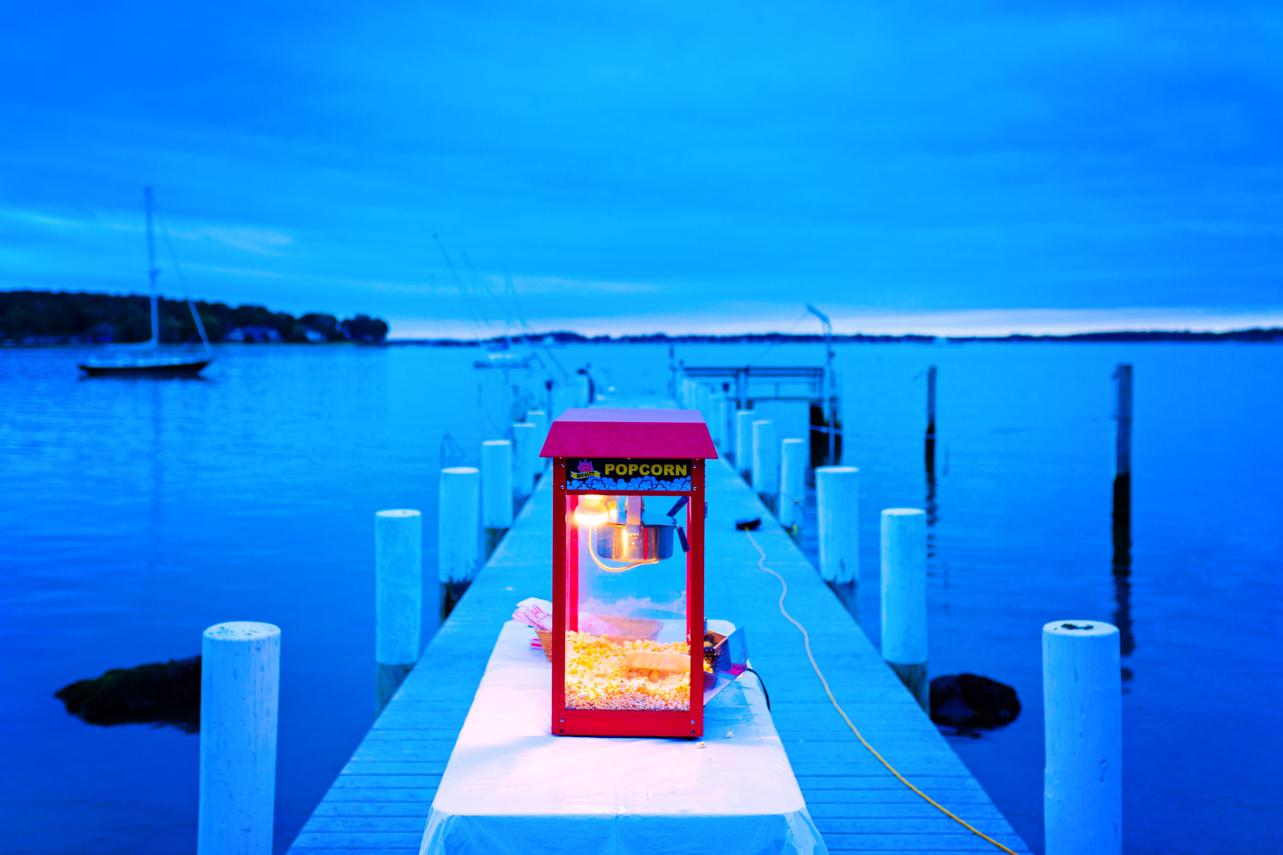 A cloudy, blue sunset and a red popcorn maker at the Modica family home on Shelter Island, NY.Charles and Lisa Modica hosted a post-wedding party for Sarah Cahill and Jack DaSilva on October 2, 2016.