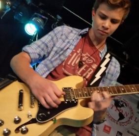 John playing a solo