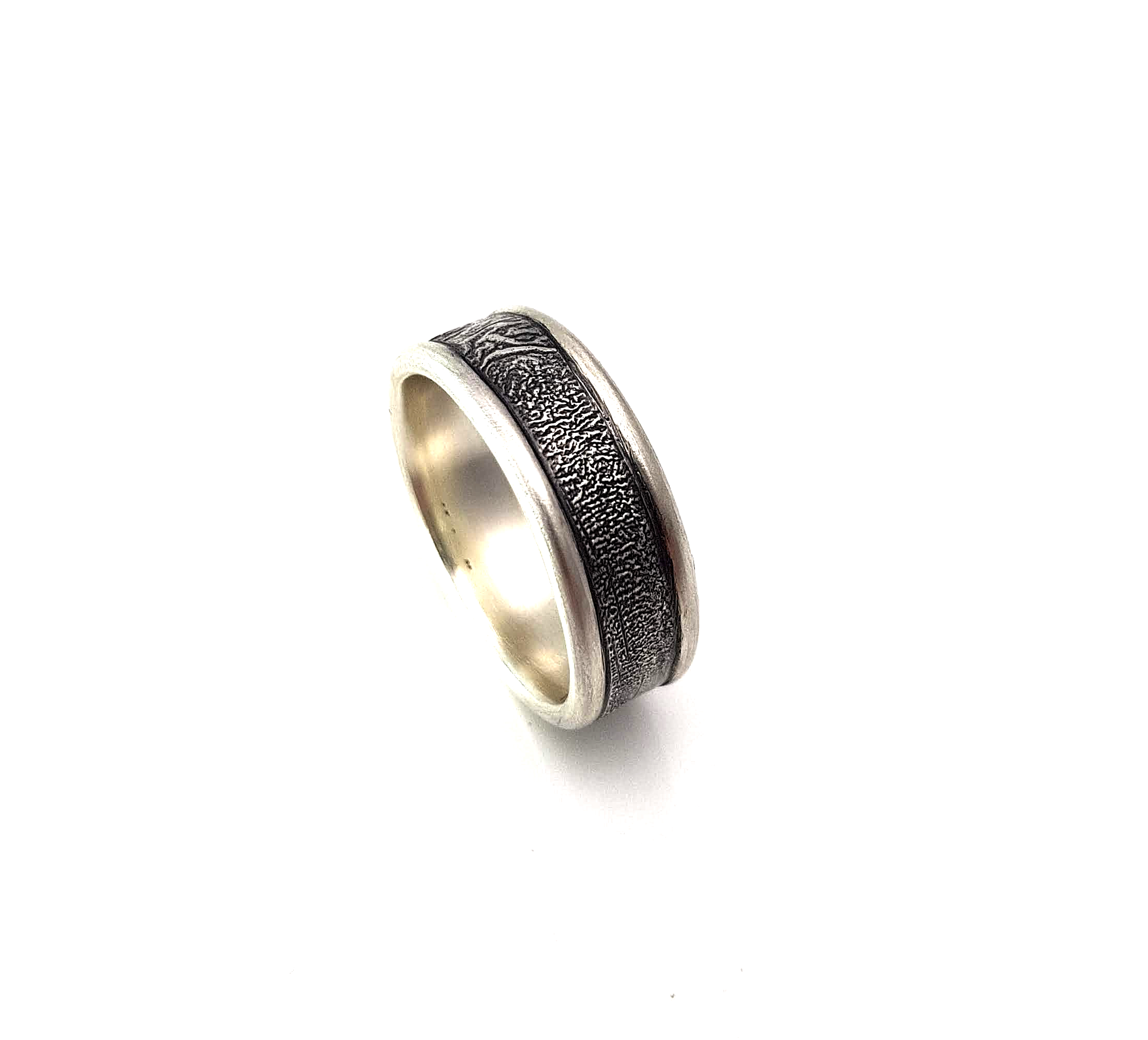 Jason's wedding   Jason loved the edged rings and the Rippled texture. Made from sterling silver, oxidised and just ever so slightly thicker.