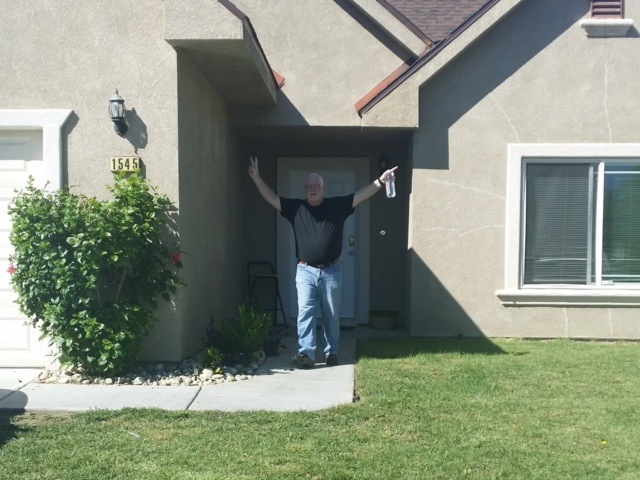loving life - man in front of house.jpg