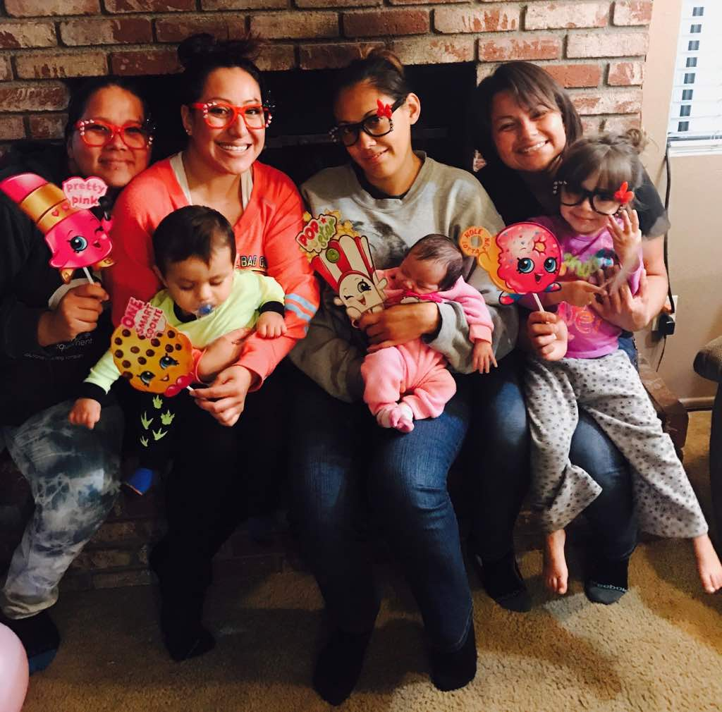 The moms and children showing off their new arts and crafts creations.