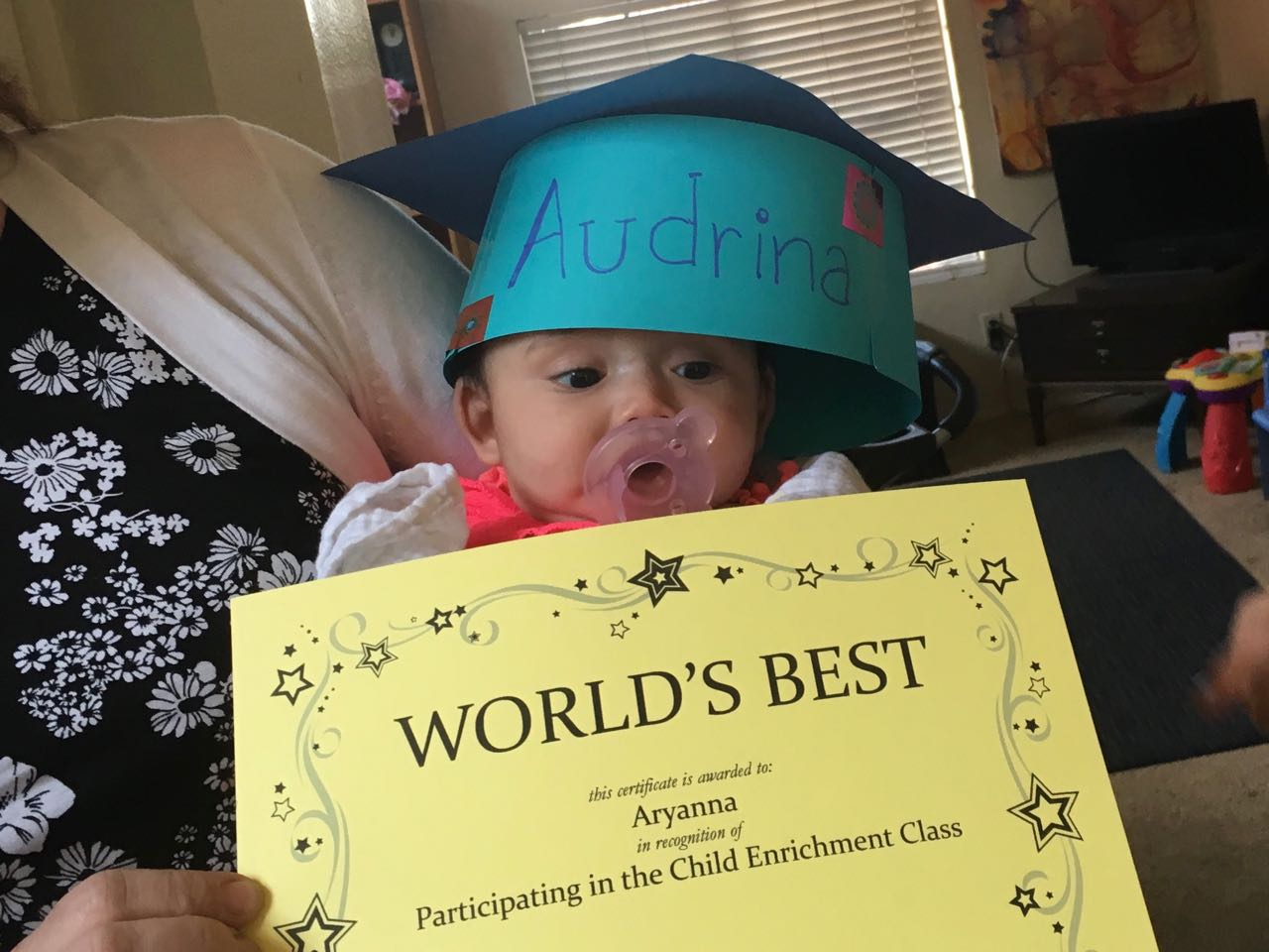 Adrina is very proud of her World's Best award