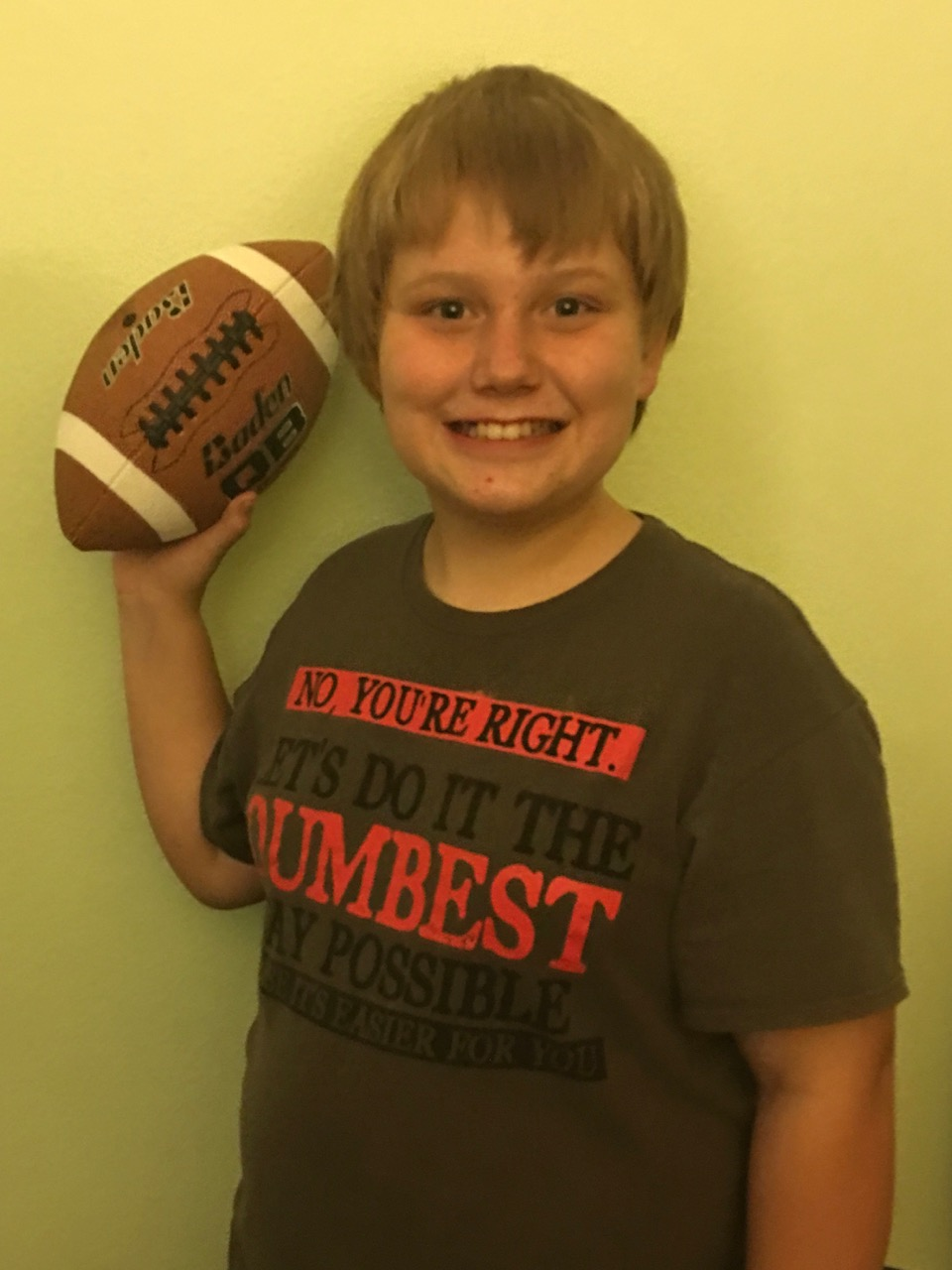 This young man is quite happy with his new football.