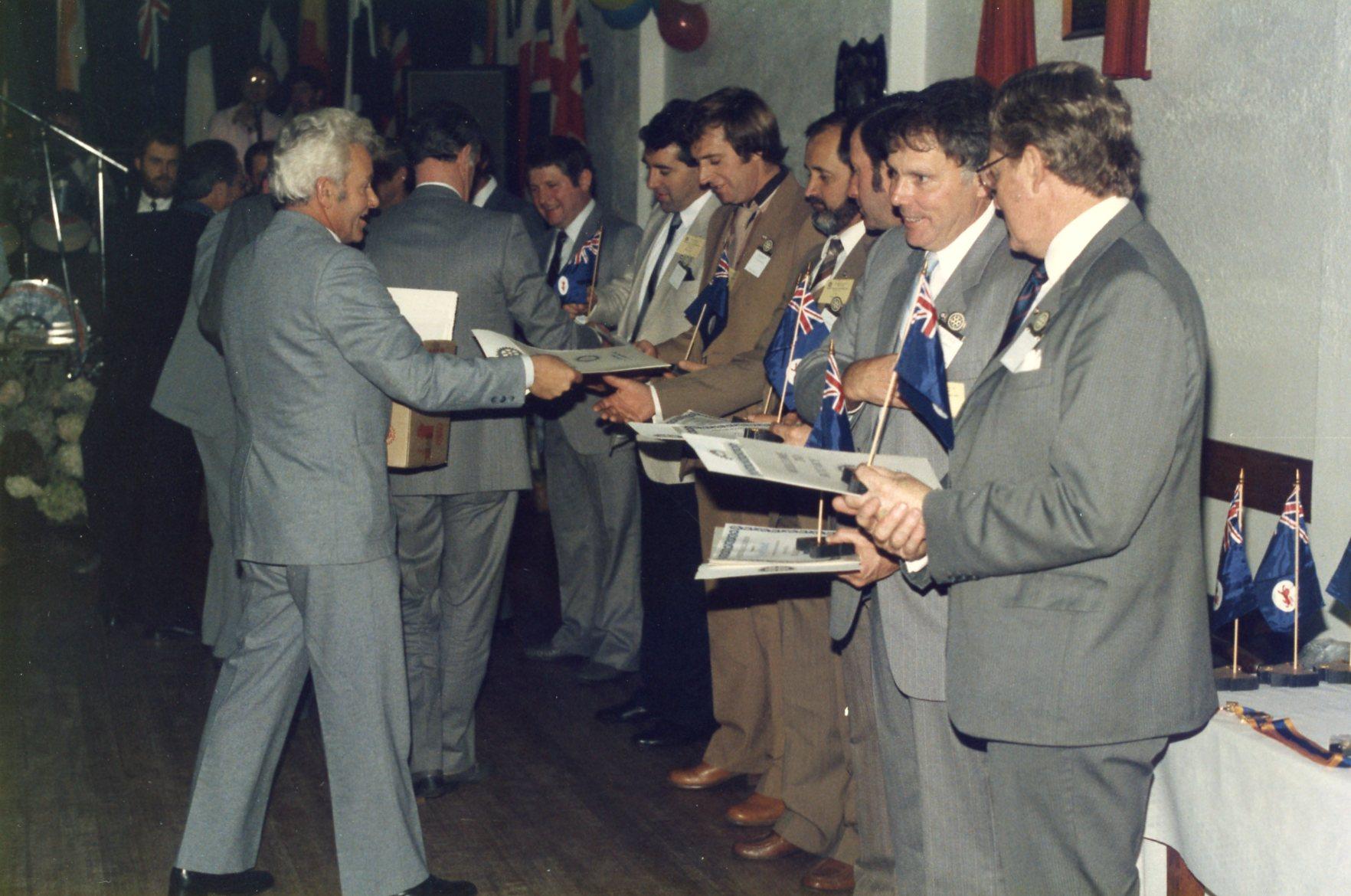 Charter members receive their membership certificates