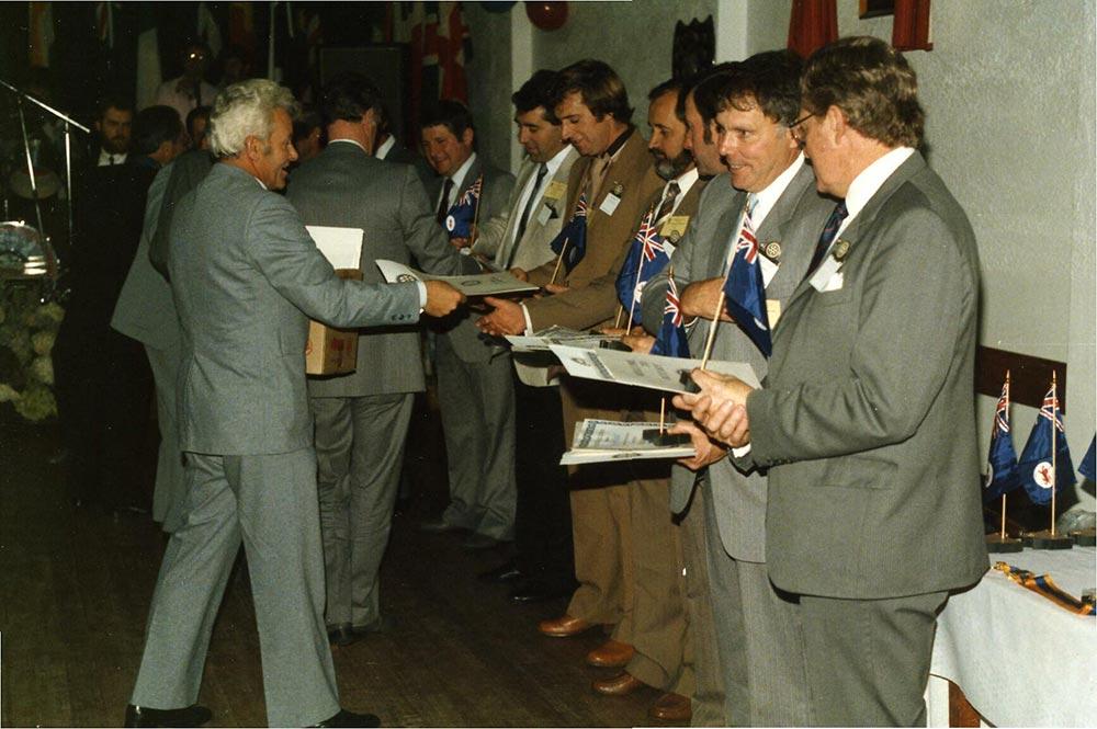 Charter members receive their membership certificates.