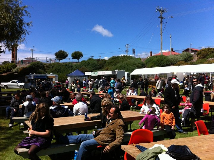 Patrons enjoying the fabulous variety of food and beverages while being entertained by the musicians