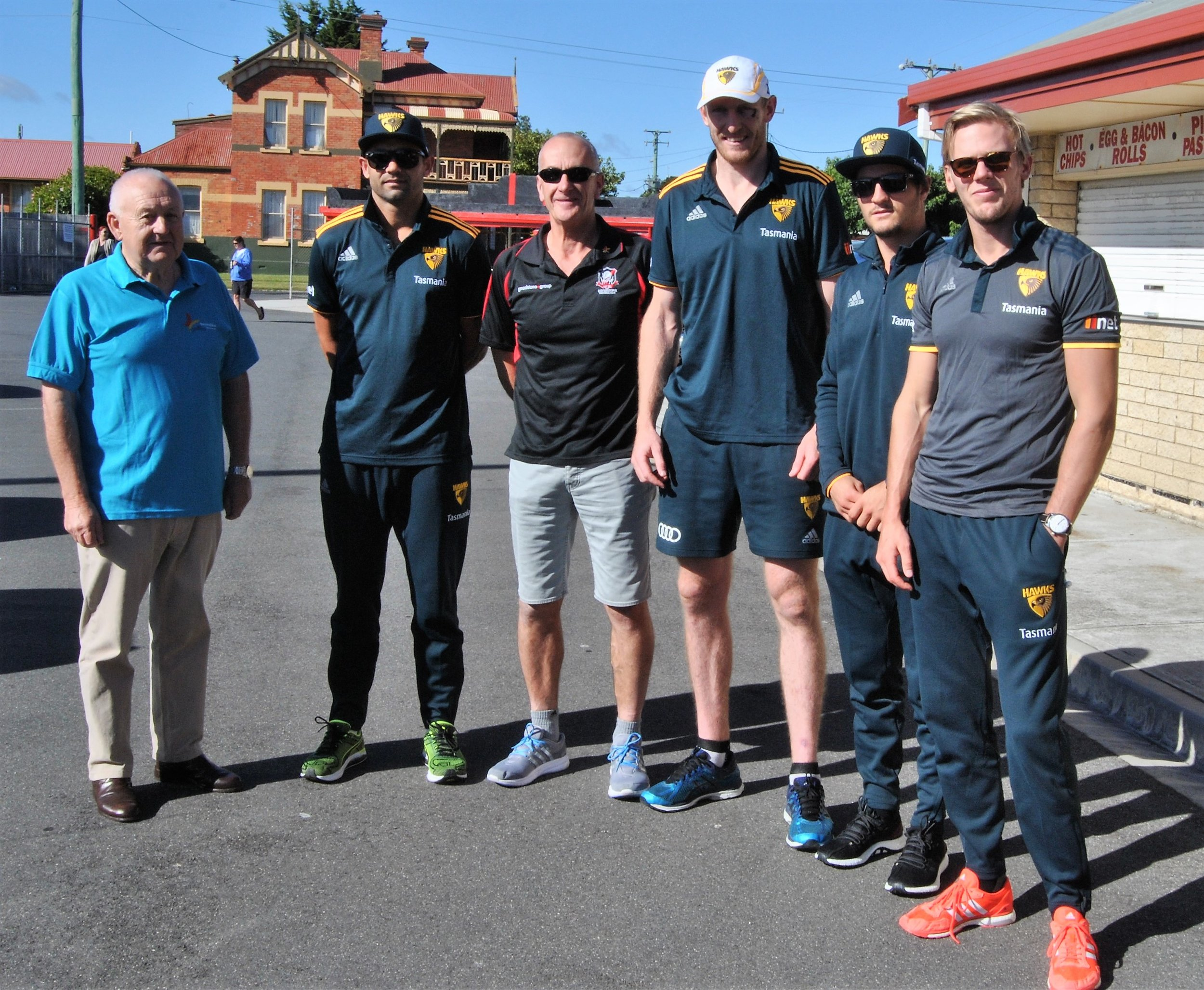Rotarian Lindsay Morgan with Hawthorn players Ben McEvoy, Shaun Burgoyne, Will Langford and Kade Stewart, and support staff manager Kristian Hall