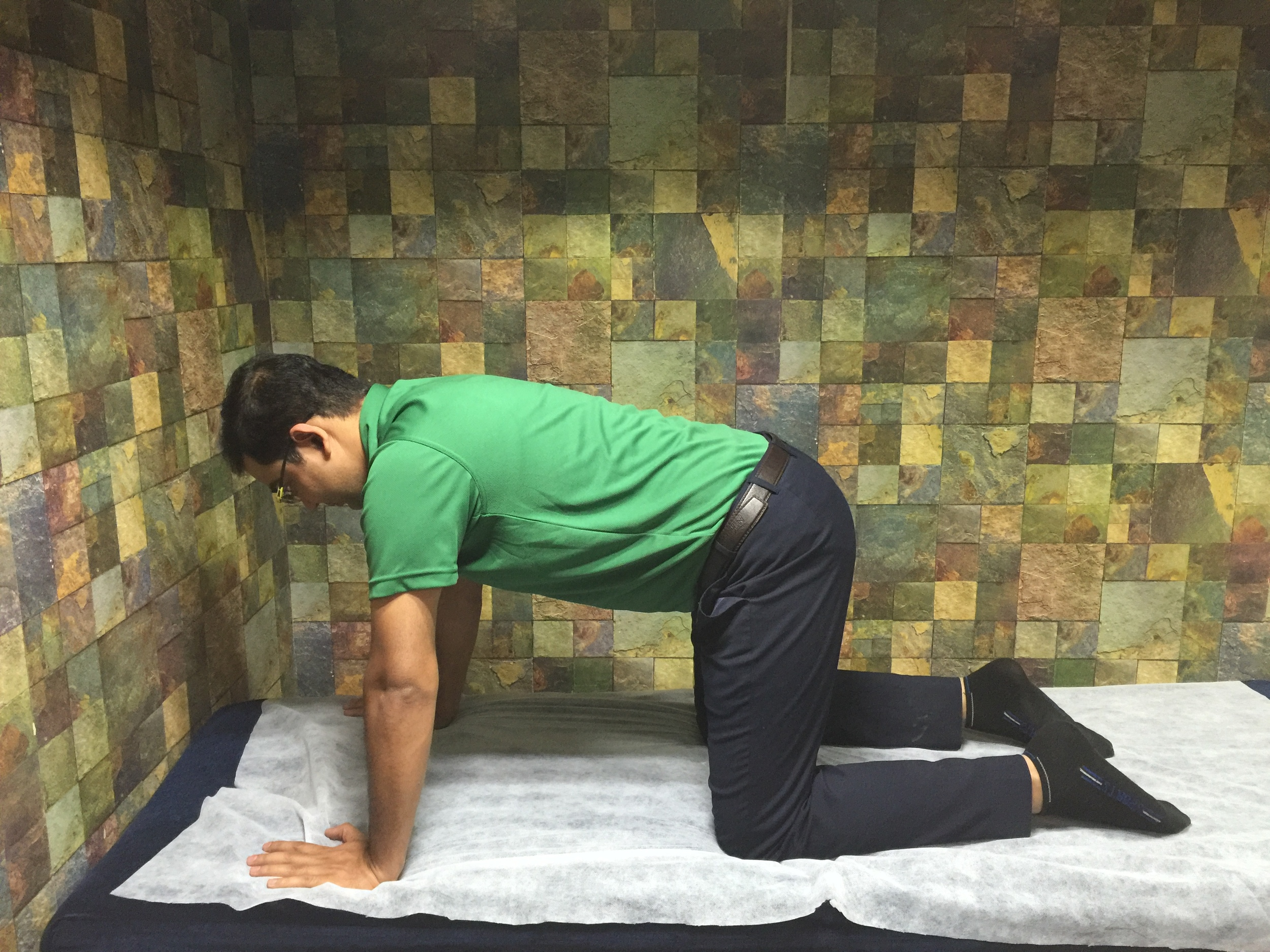 Get on all fours. Place your feet shoulder-width apart and your elbows right under your shoulders.