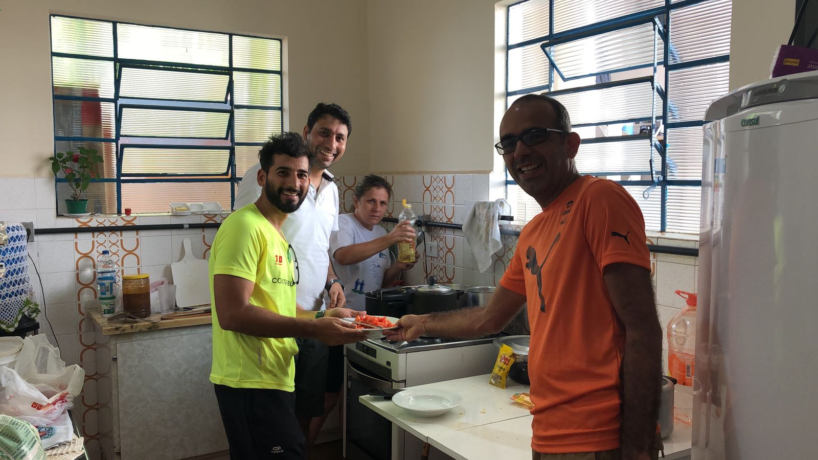 Praveen, Munish and Mandeep preparing the Indian flavour for the Brazilian hosts.