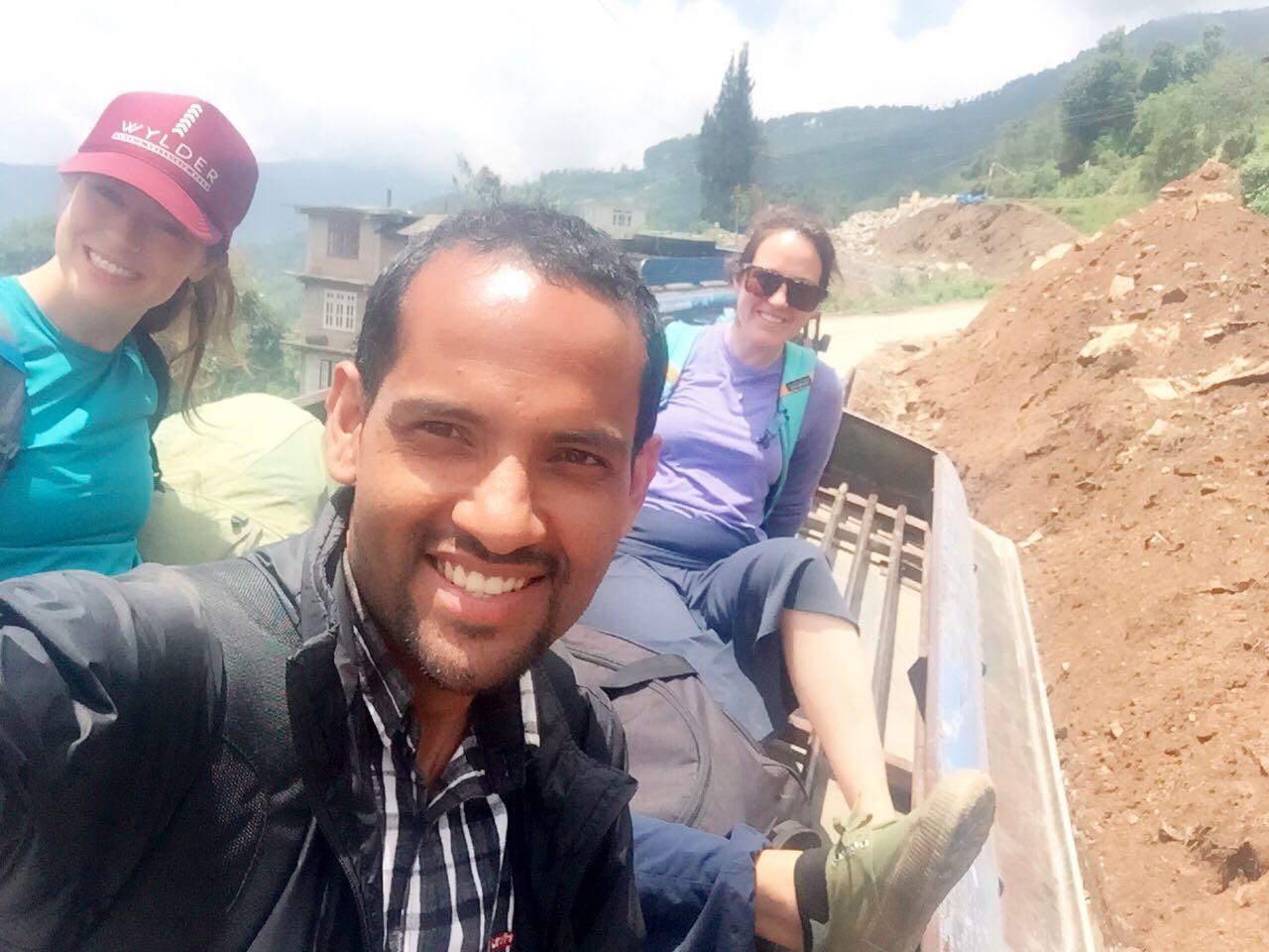 Jess, Bikash and Katie atop a bus returning to Charikot