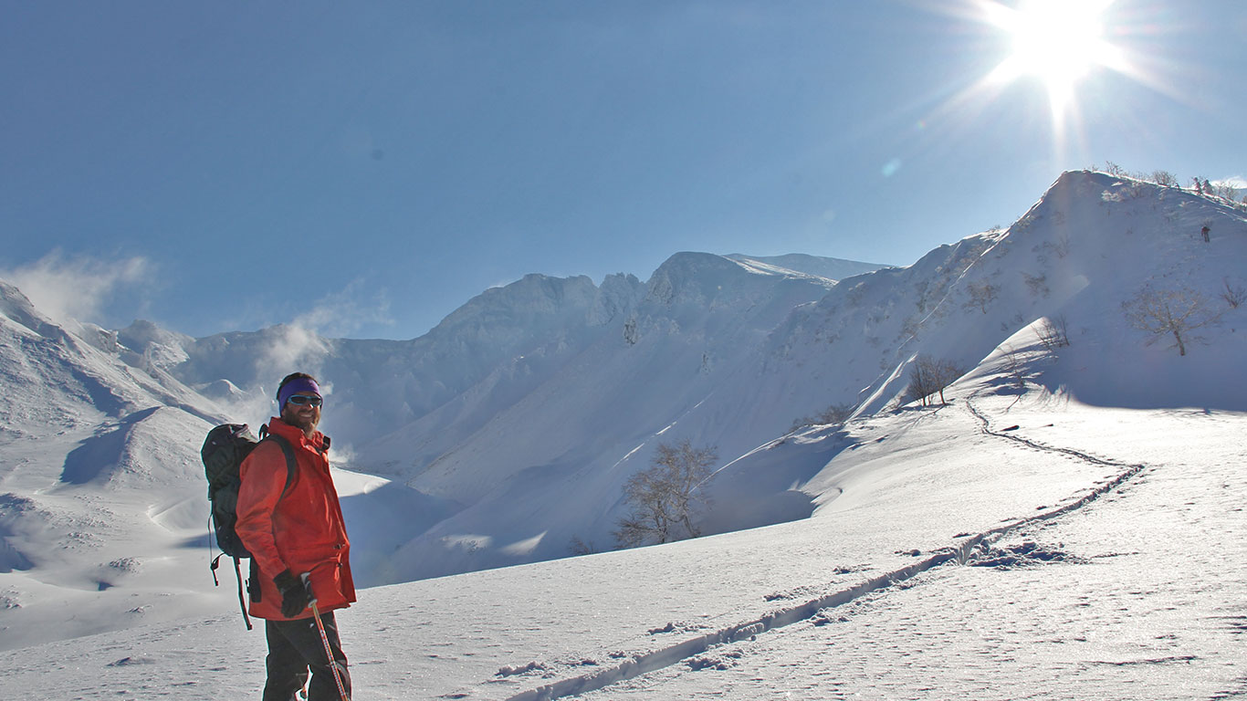 """Tokachi Mts. Climbing the """"D Ridge"""" on skins, looking for first tracks on a bluebird day."""