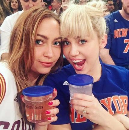 Miley-Cyrus-wears-her-engagement-ring-to-Knicks-game.jpg