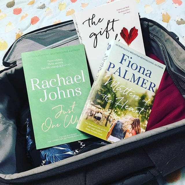 Trying to fit my stuff into carry on luggage for the RWA conference... Possum says I've packed too many books and nothing crunchable. She has a point - but I can't leave these fab books behind! 😁🐶 @rachaeljohnsauthor @fiona_palmer @josephine_moon #womenwriters #australianwomenwriters #aussiefiction