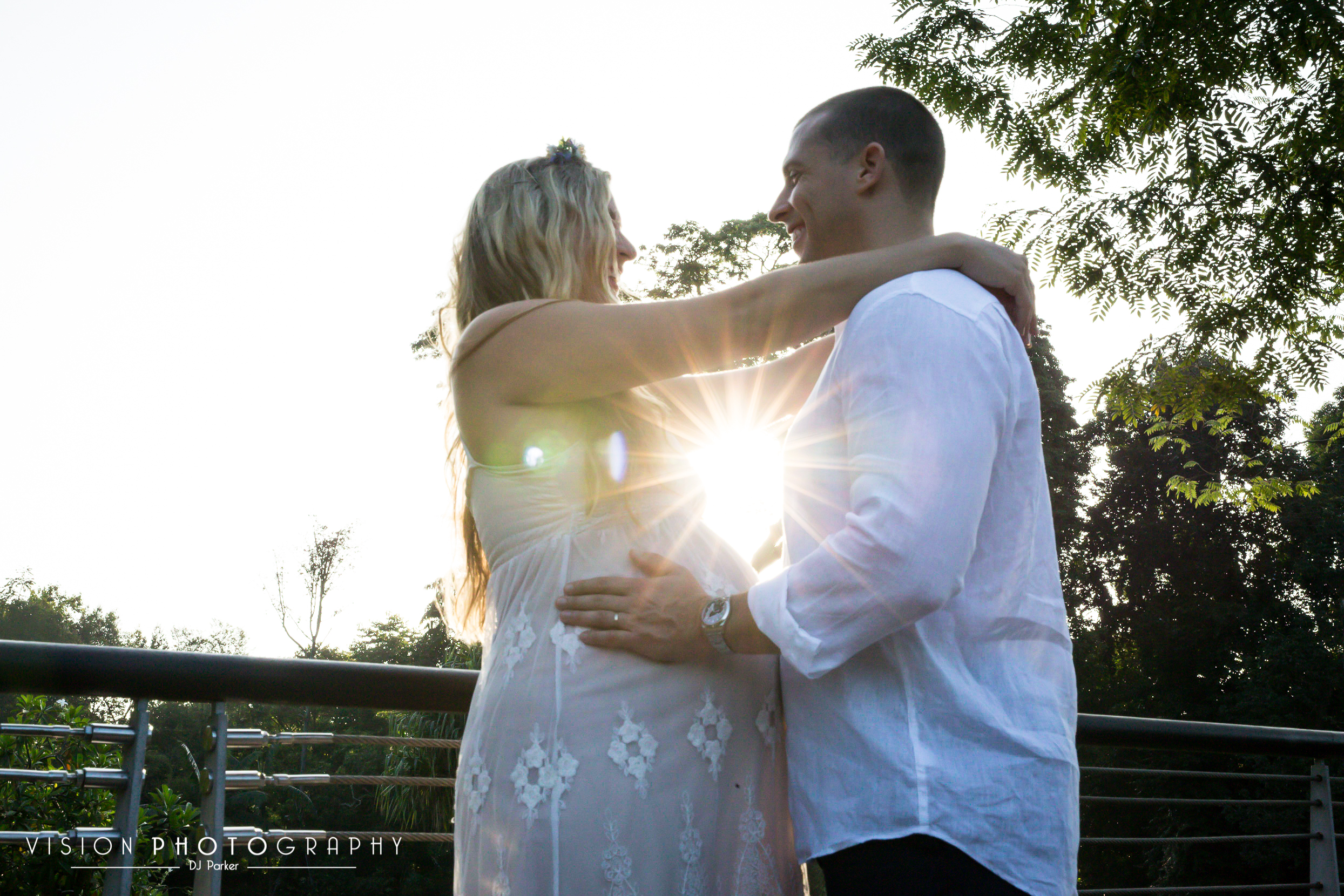 Outdoor maternity sun burst lens flare