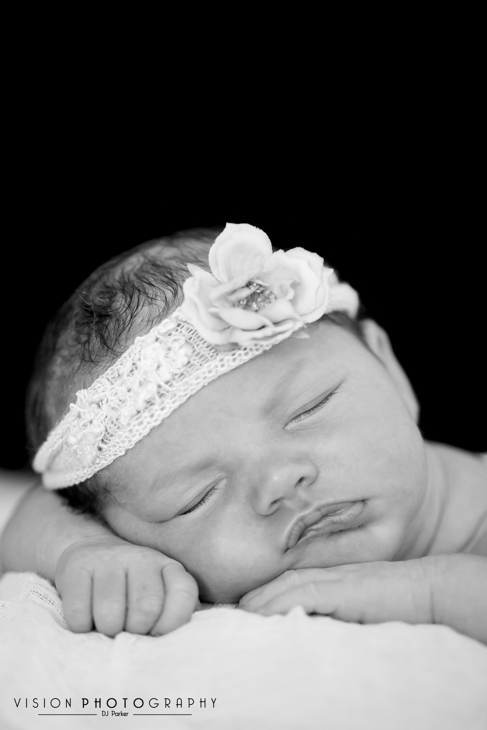 Newborn studio photography black background