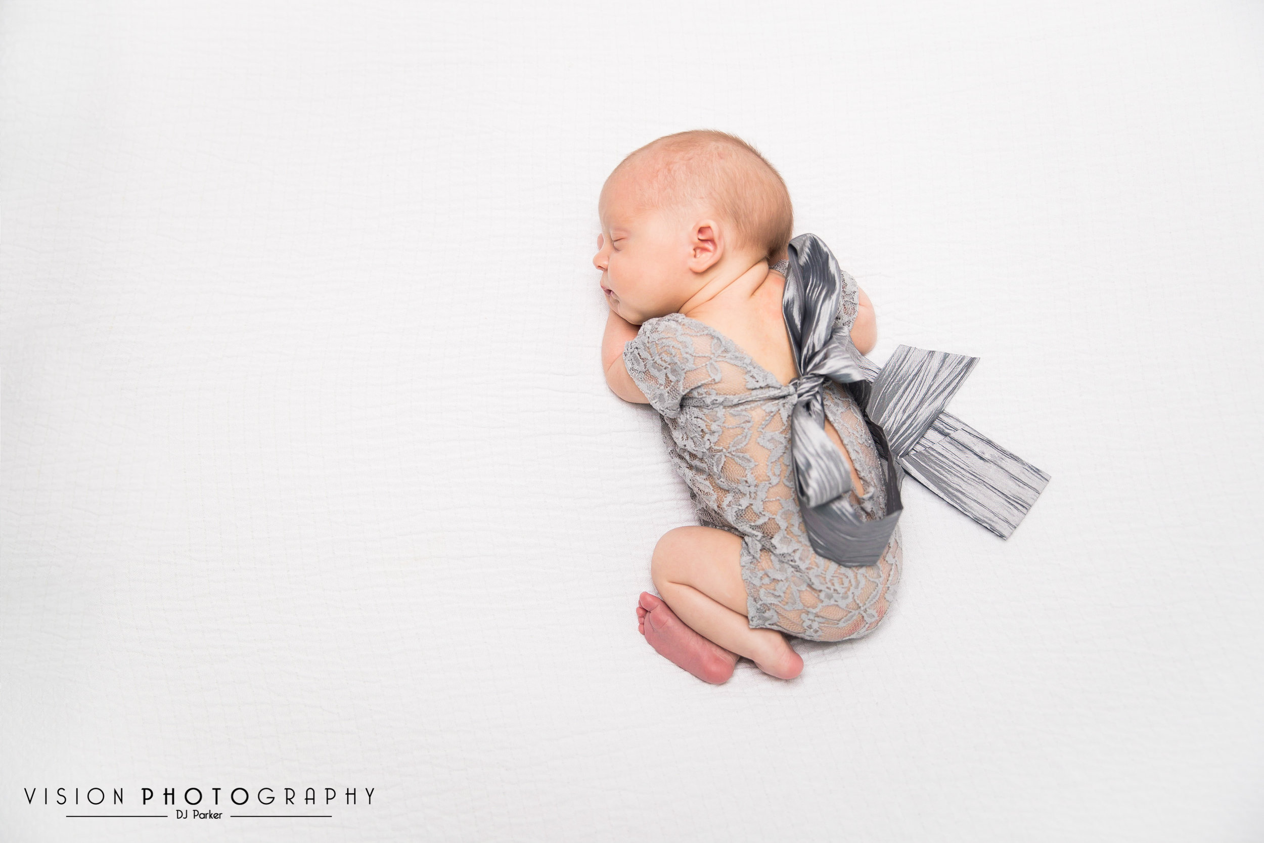 Newborn studio photography bean bag poser